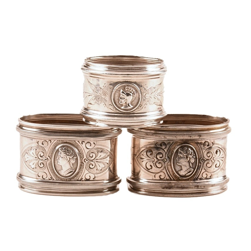 Two Sterling Silver and One Coin Silver Medallion Napkin Rings