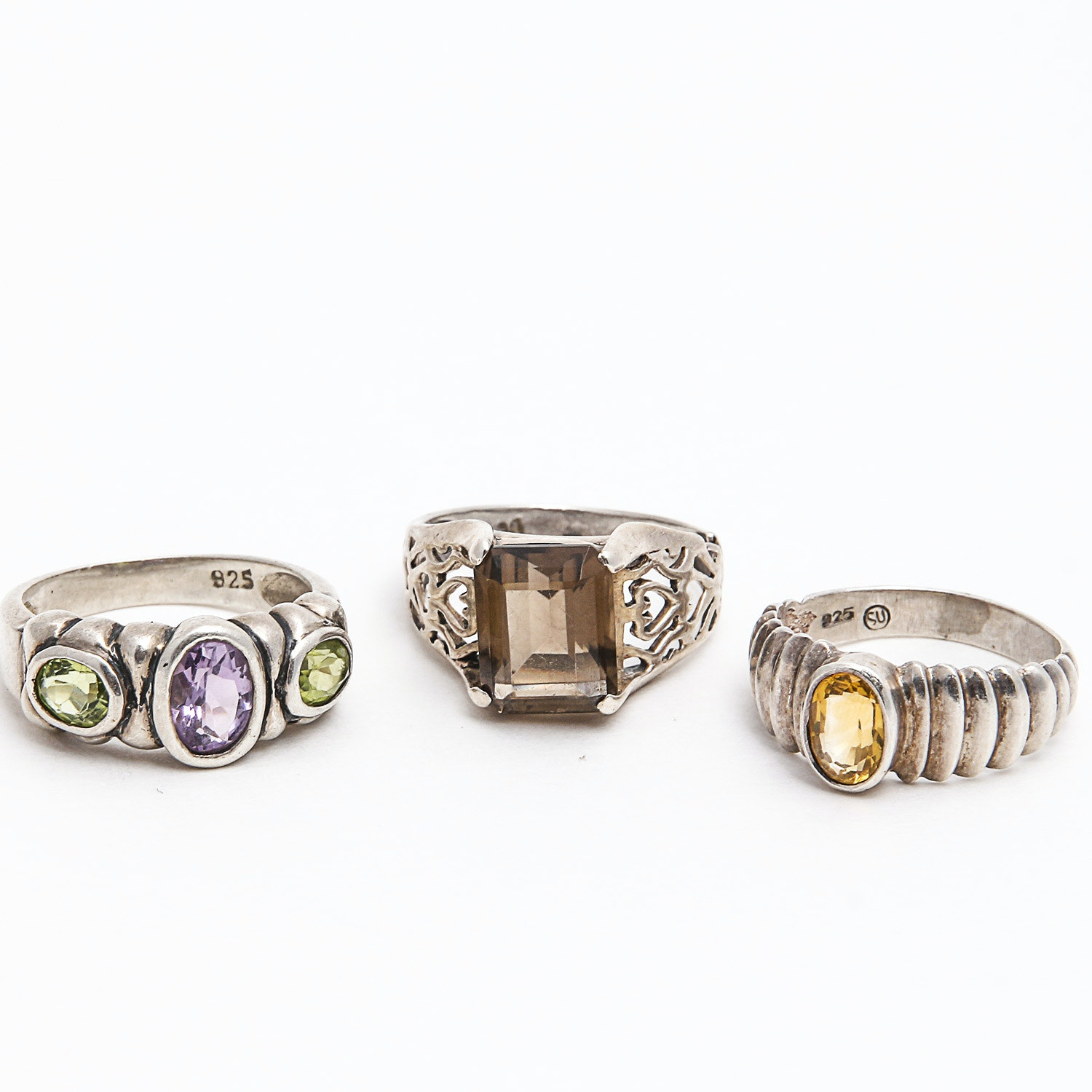 Three Sterling Rings with Amethyst, Peridot, Smoky Quartz and Citrine