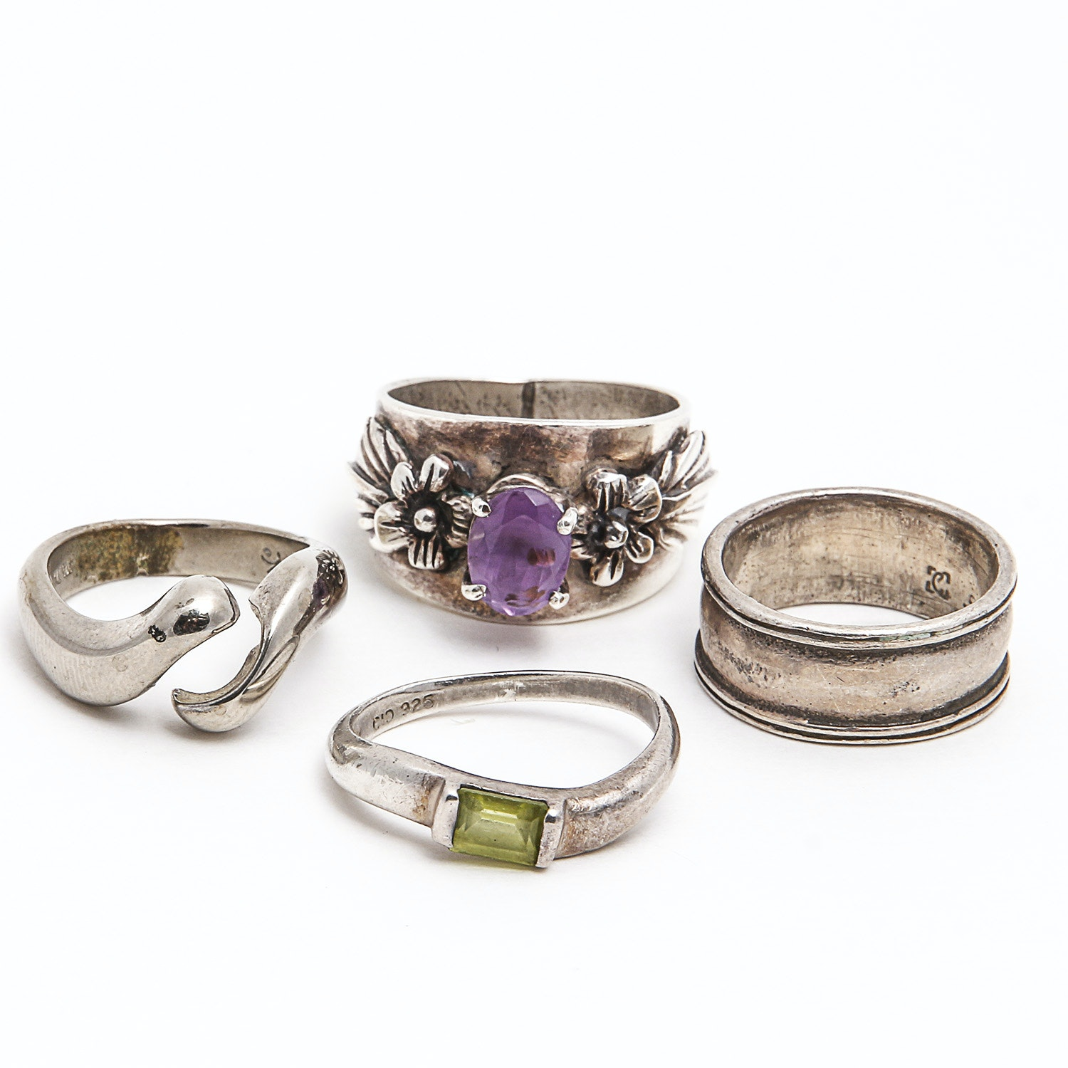 Four Sterling Rings Including Amethyst and Peridot