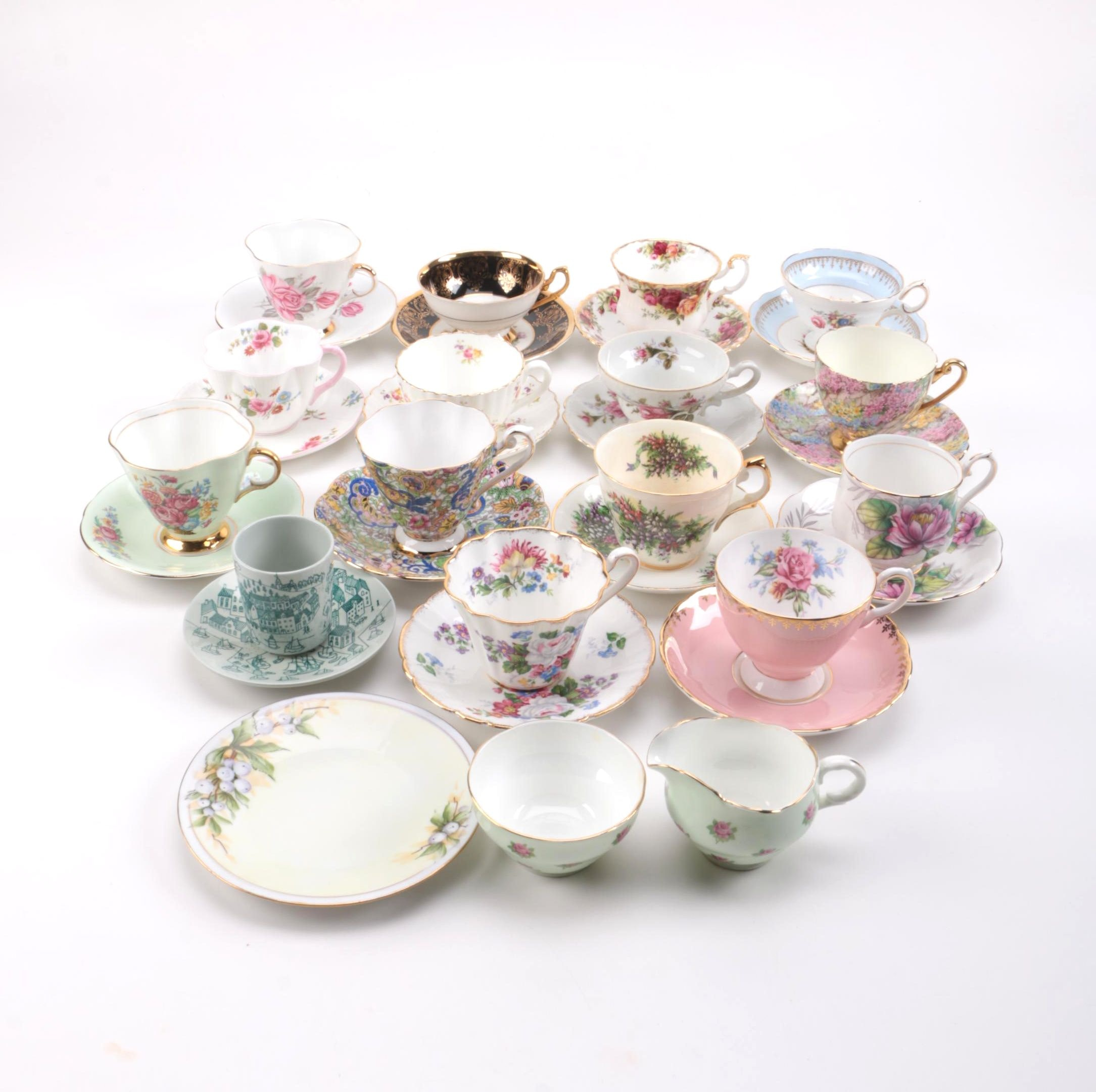 Floral Teacups and Saucers with Creamer and Sugar