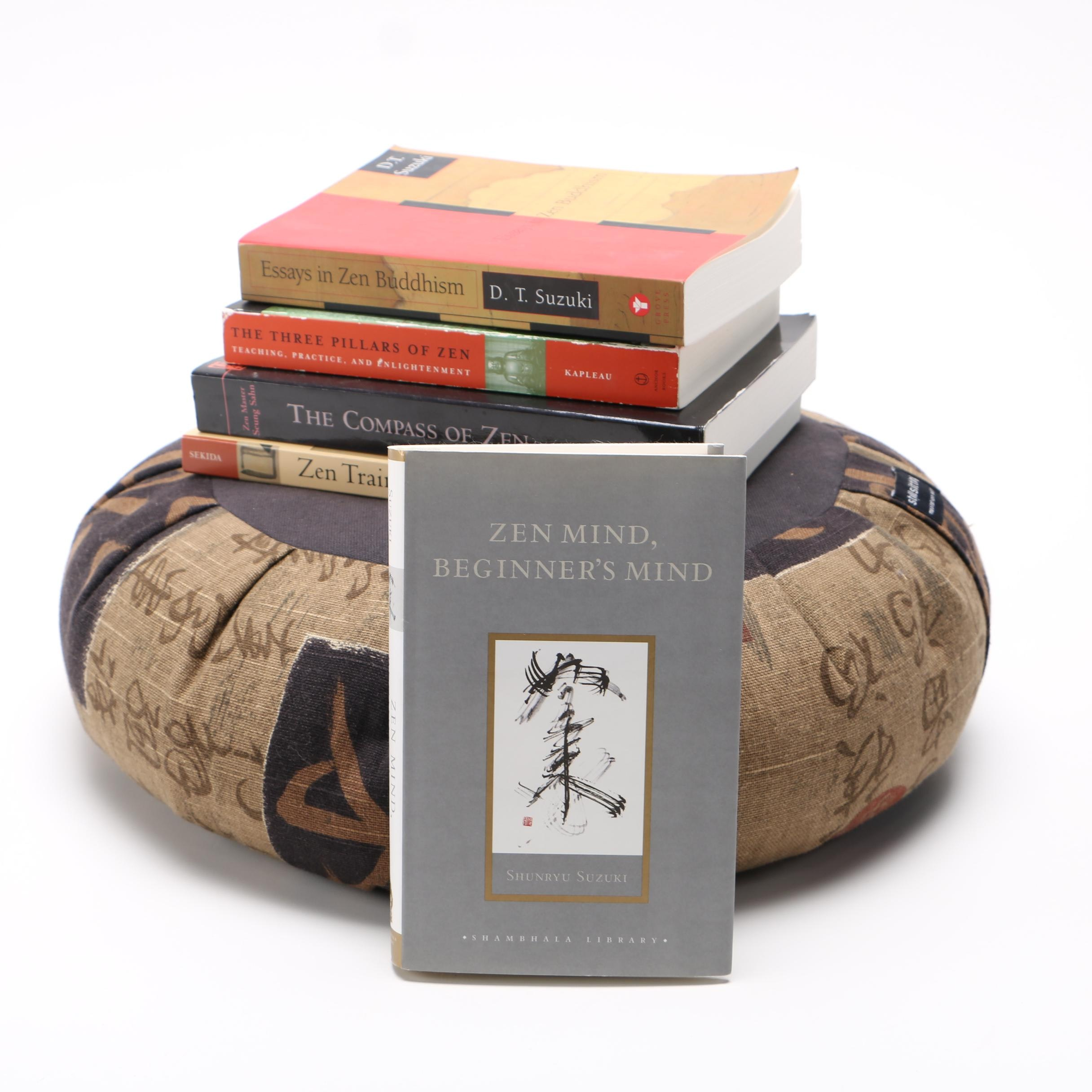 Meditation Pillow With a Collection of Books on Zen Philosophy