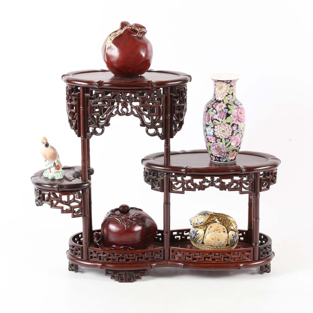Carved Wooden Display Stand with Decorative Accents