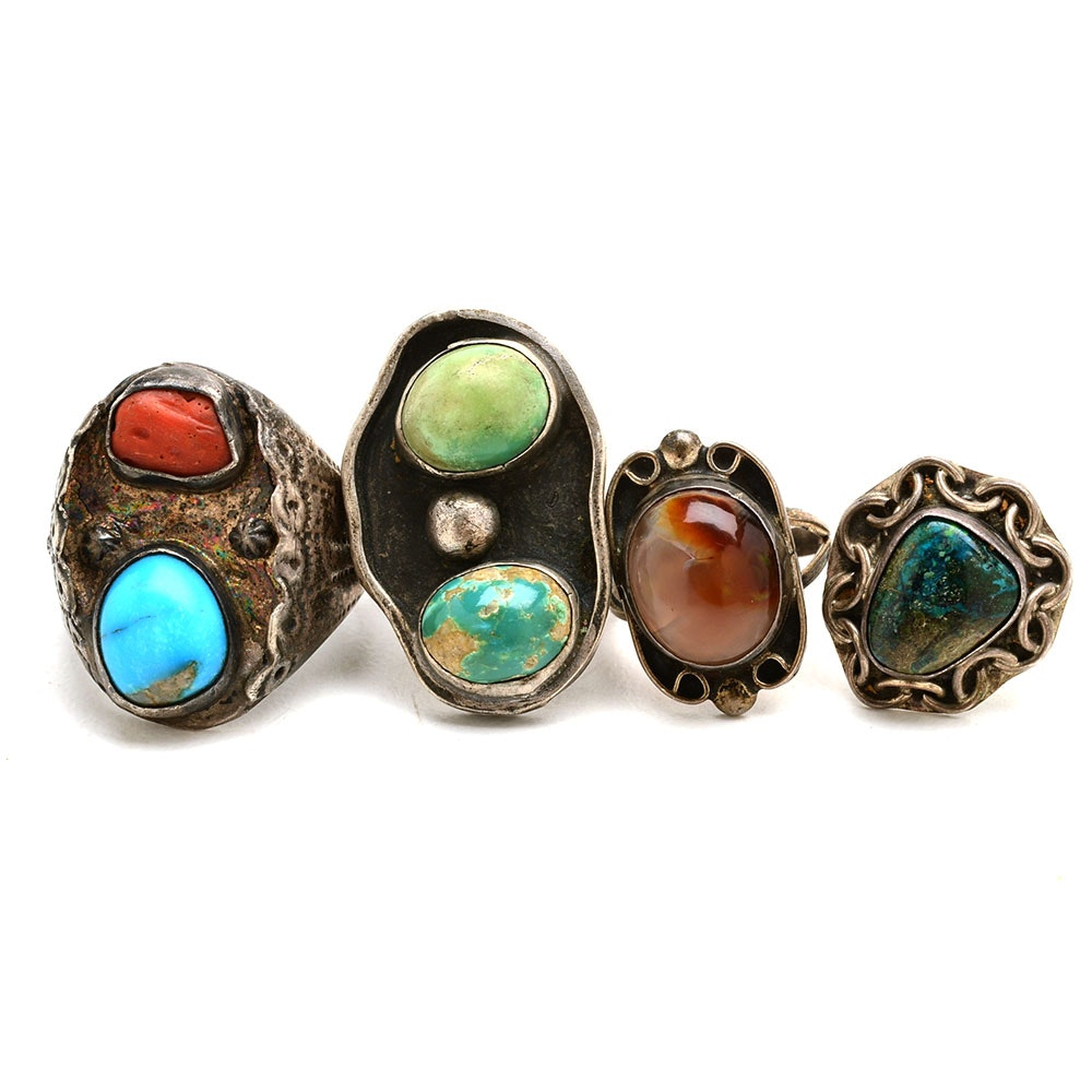Four Sterling Rings Featuring Turquoise, Coral and Fire Agate