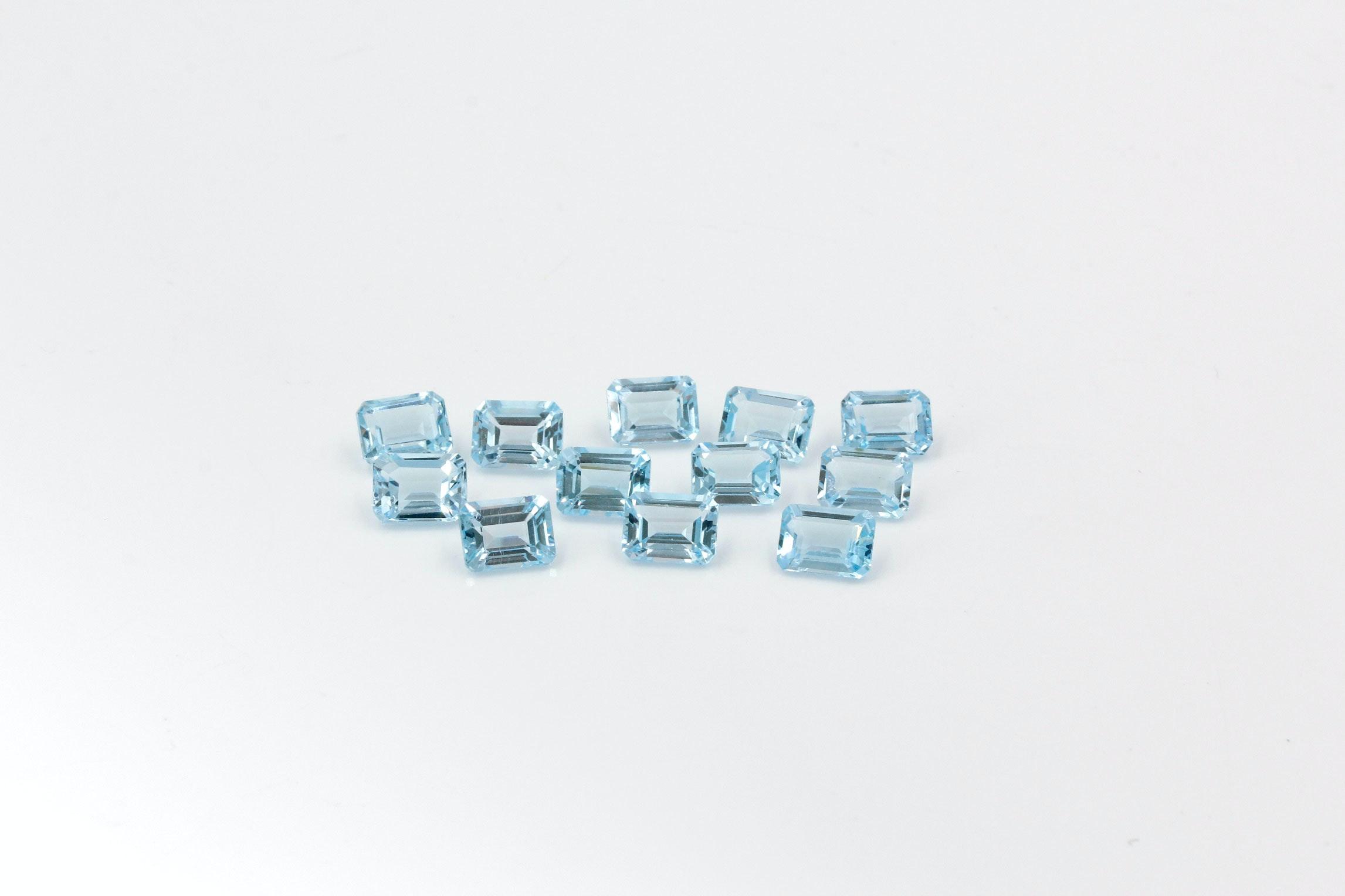 Twelve Loose Emerald Cut Blue Topaz