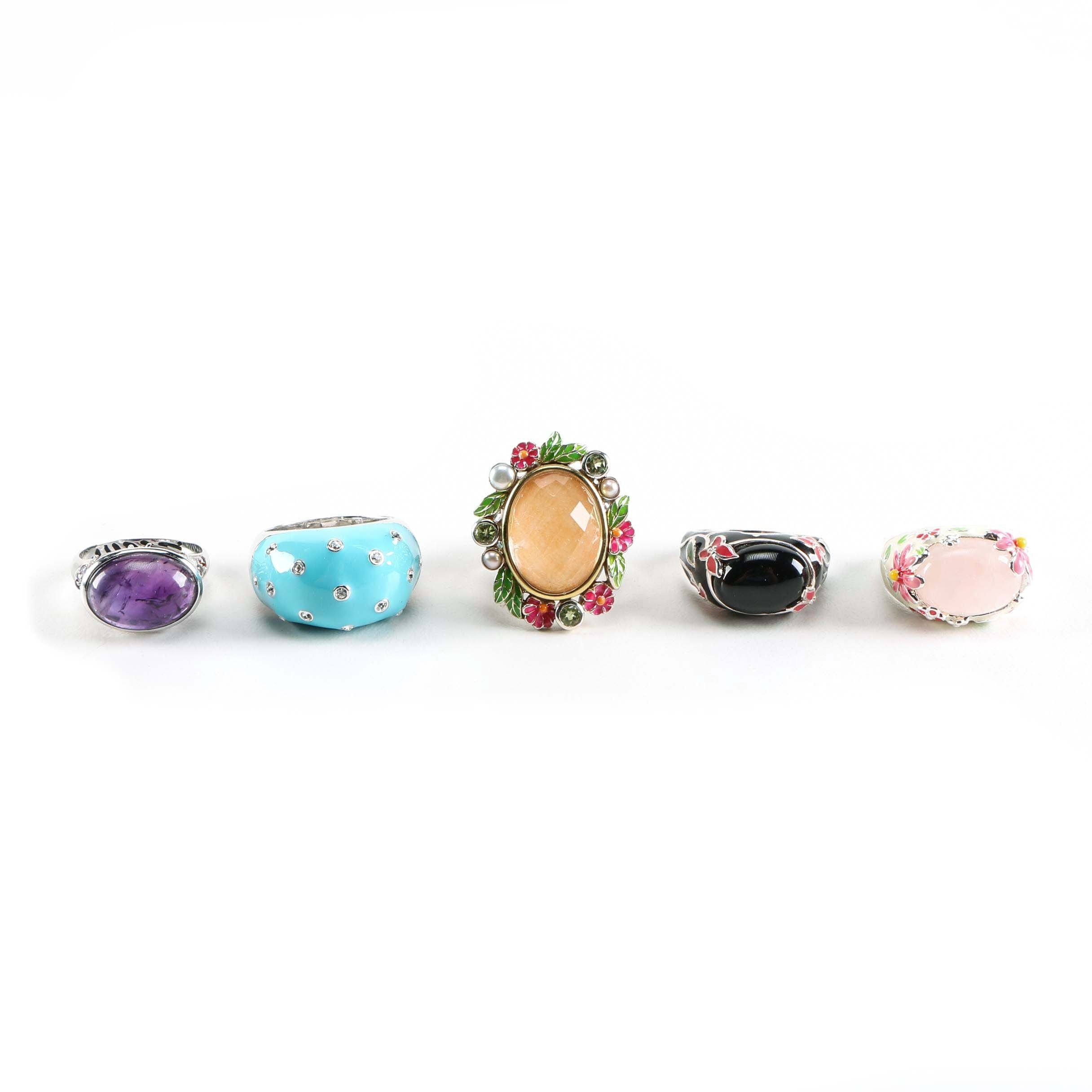 Sterling Silver Rings with Floral Motifs and Gemstones