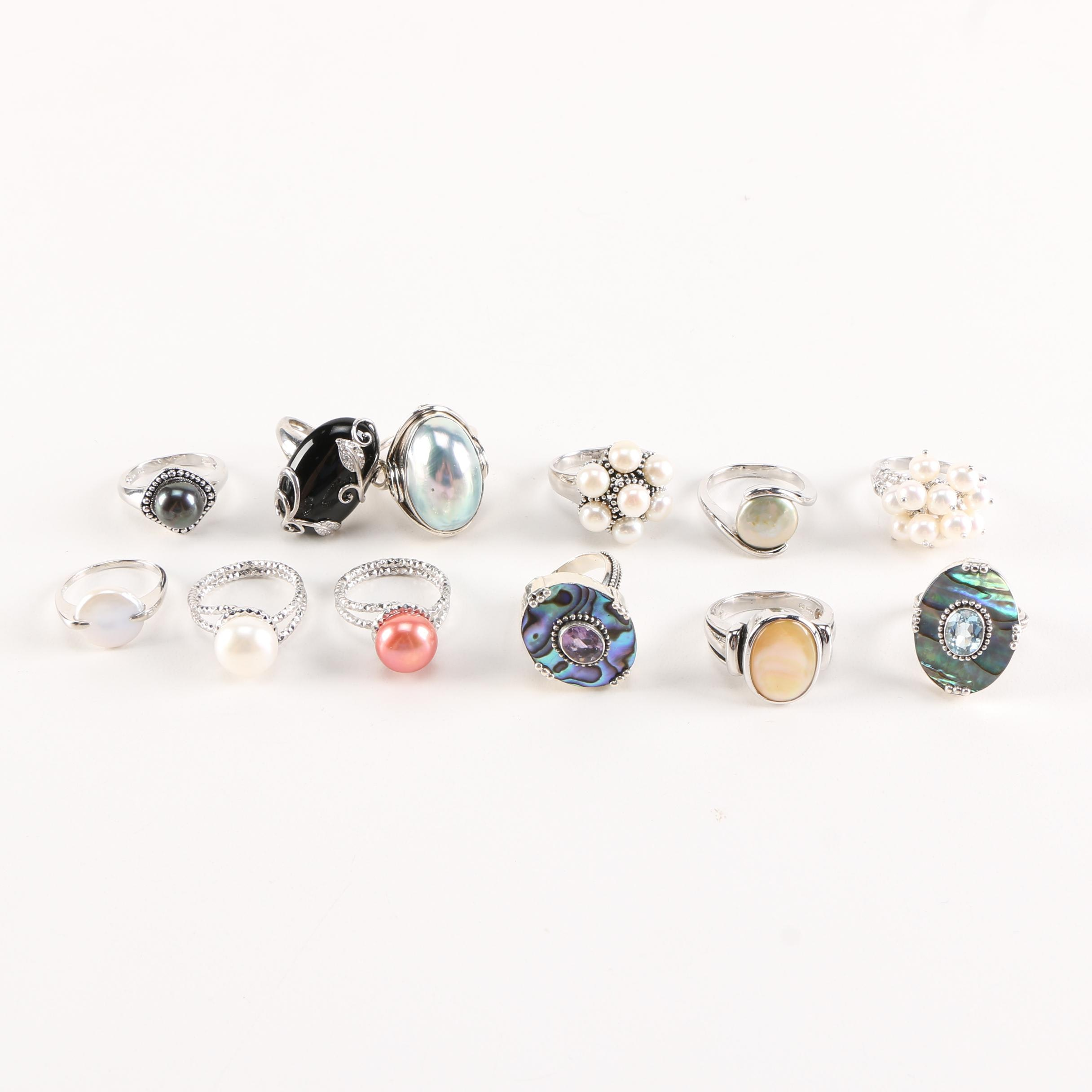 Sterling Silver Rings Featuring Various Gemstones and Cultured Pearls