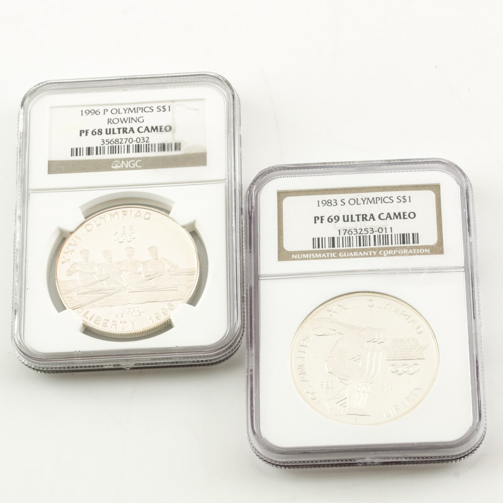 Two Encapsulated Proof Commemorative Silver Dollars