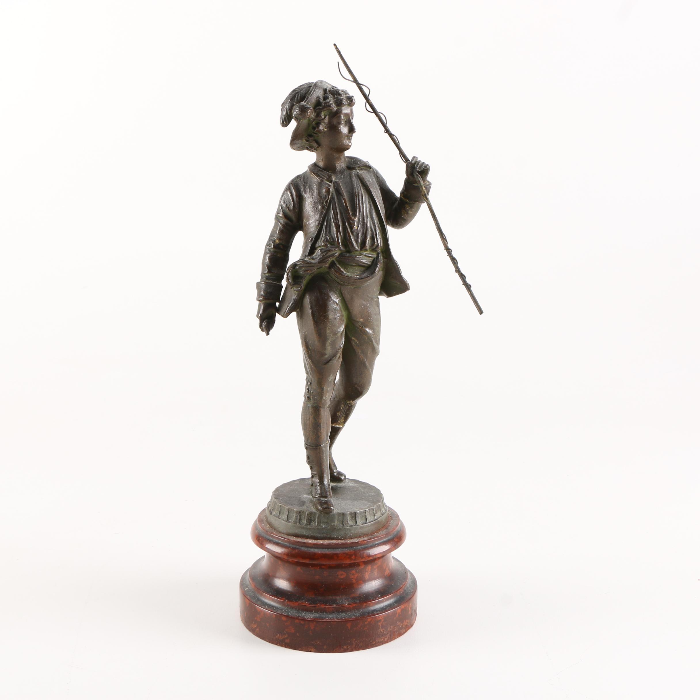 Bronze Toned Metal Sculpture of a Boy