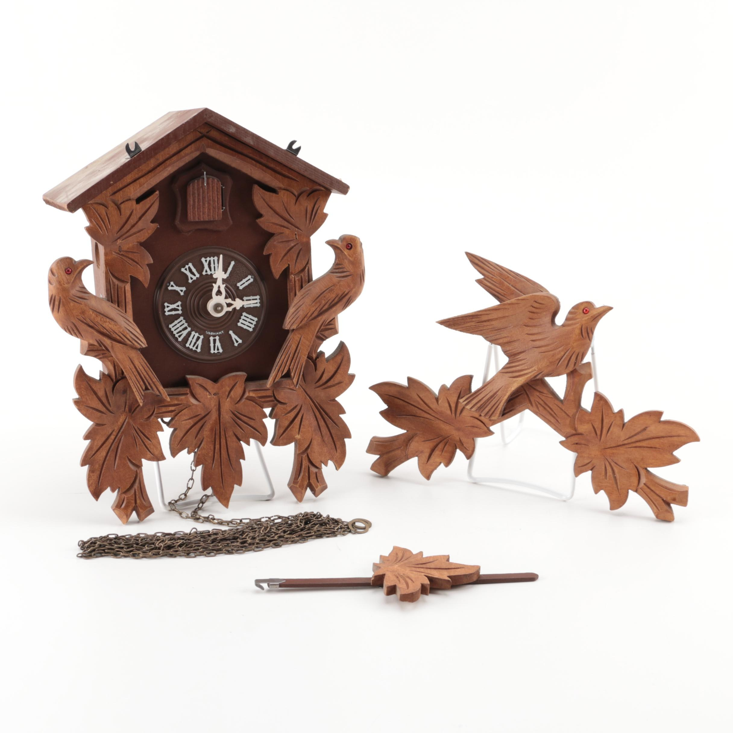 Regula German Wooden Cuckoo Clock With Carved Bird and Leaf Motif