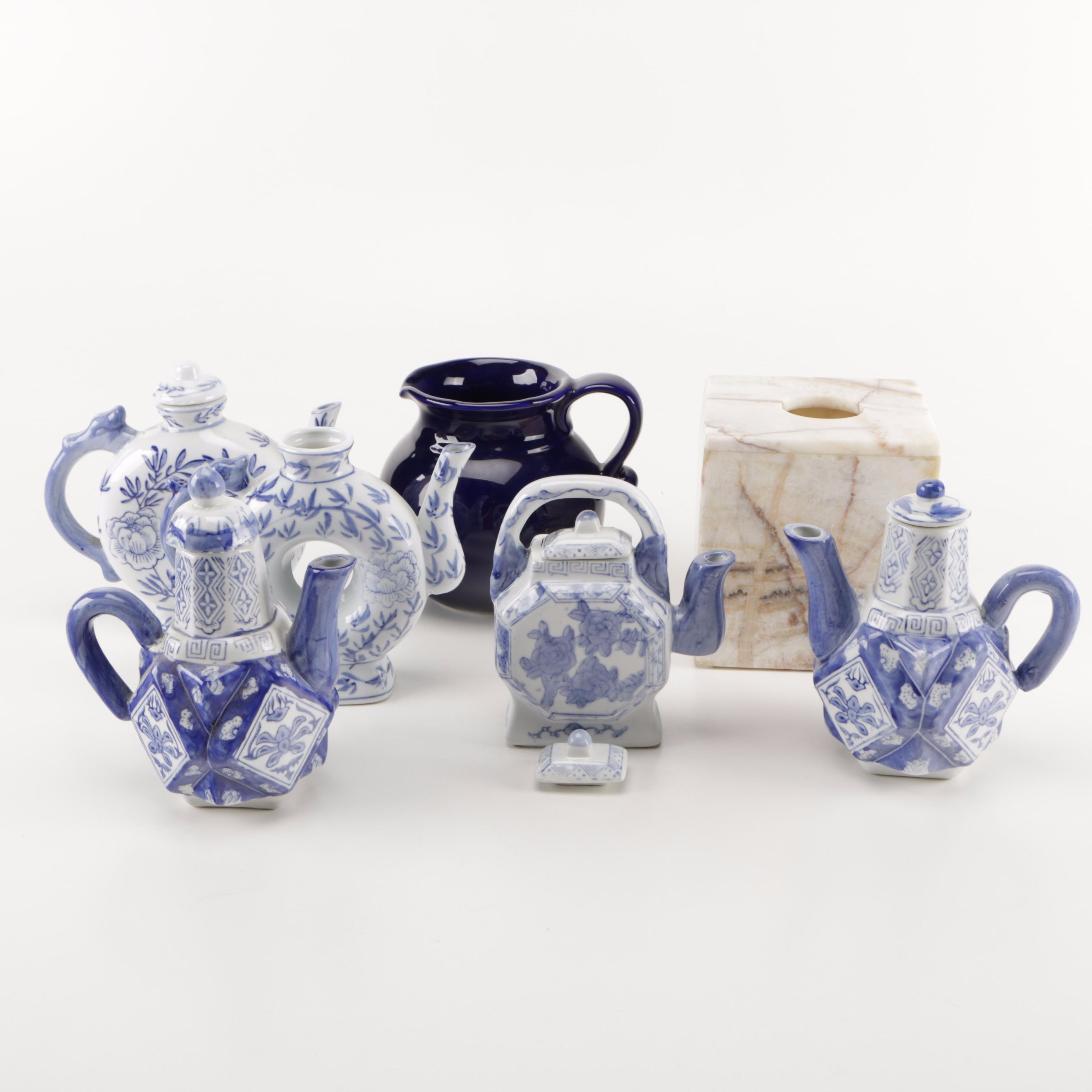 Assortment of Seven Decorative Objects Including Blue and White Teapots