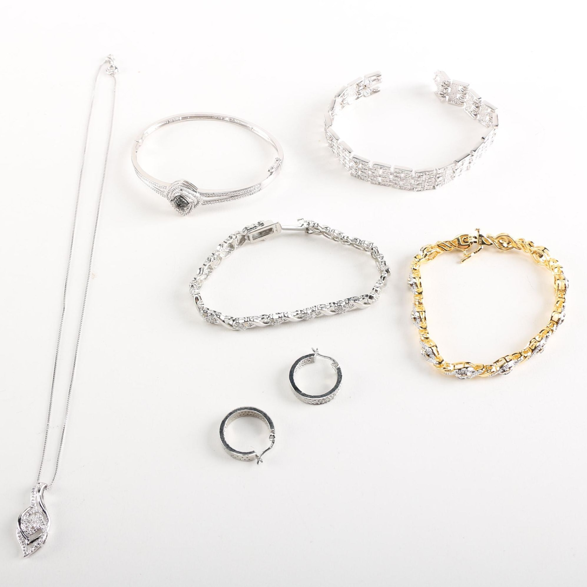 Costume Jewelry Bracelets, Earrings and Necklace With Diamonds