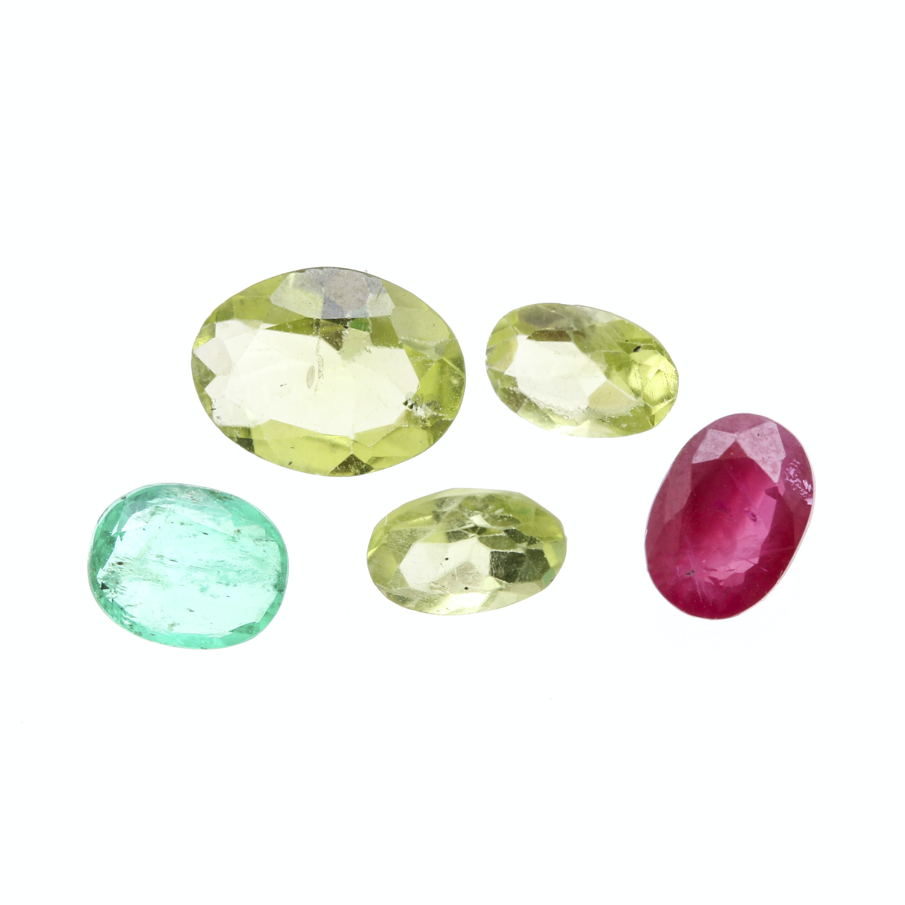 Assortment of Loose Gemstones featuring Ruby, Peridot, and Emerald