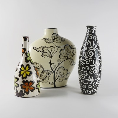Three Black Patterned Pottery Vases