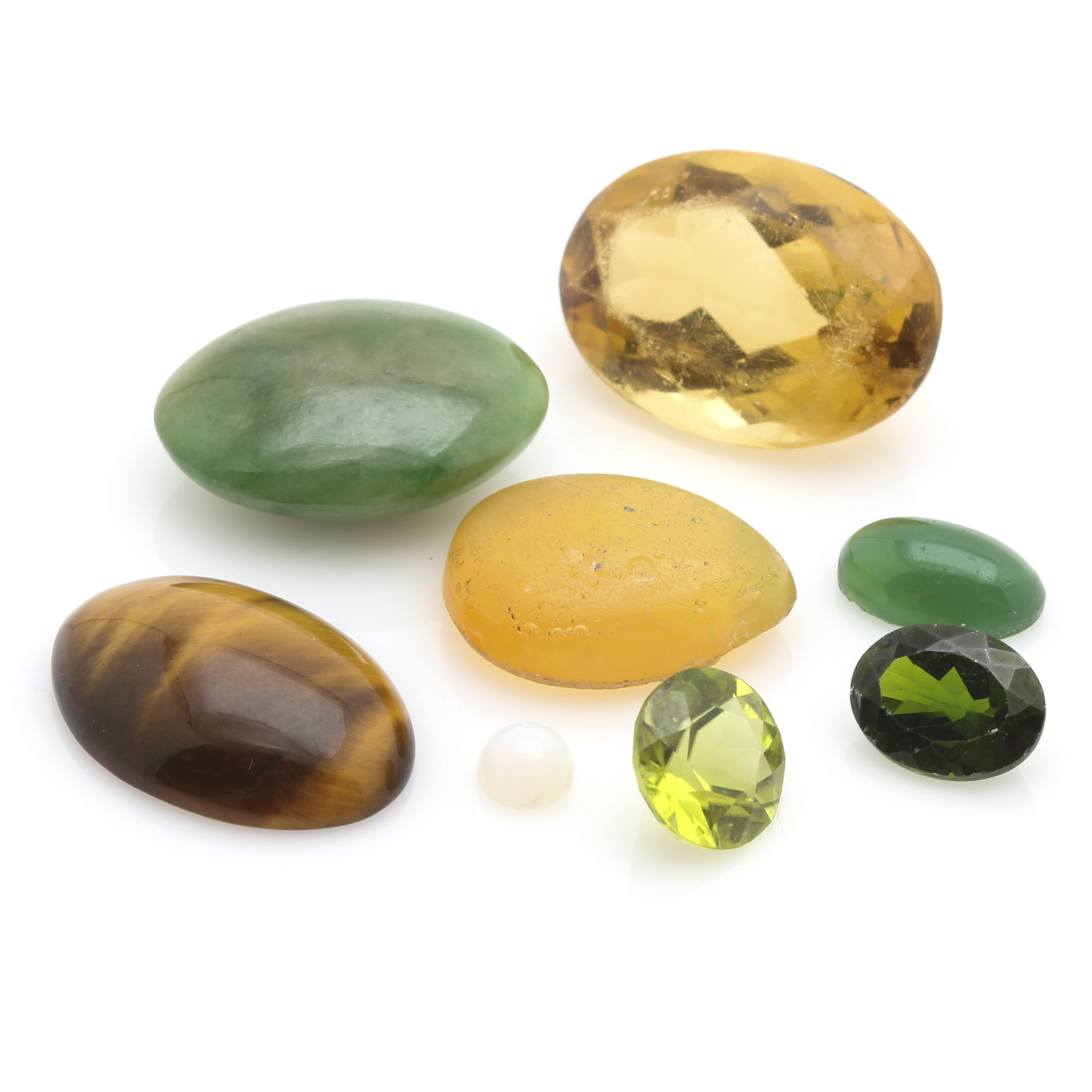 Assortment of Mixed Loose Gemstones featuring a 5.15 CT Opal and a 13.25 CT Citrine