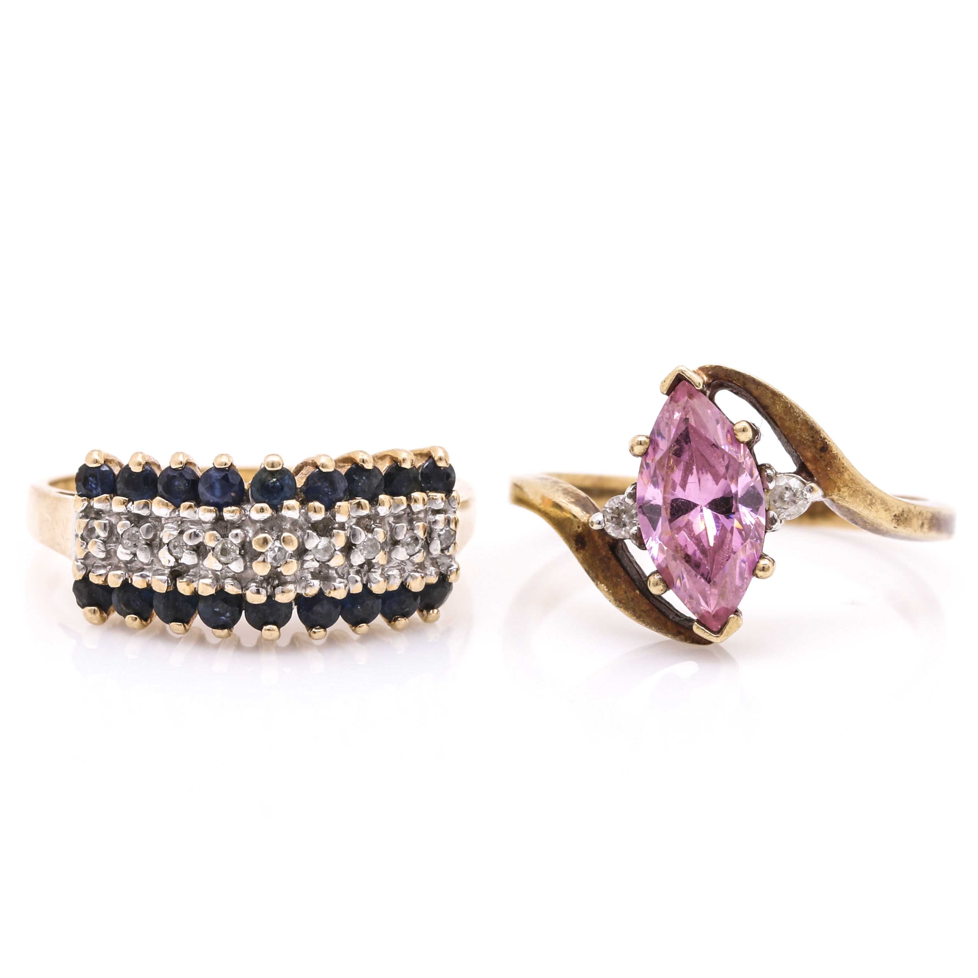 Two 10K Yellow Gold Rings Featuring Diamonds, Sapphires and Cubic Zirconia