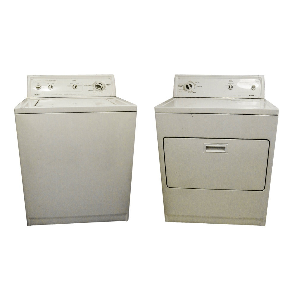 A Kenmore 80 Series Front Load Washer And Top Load Dryer Set