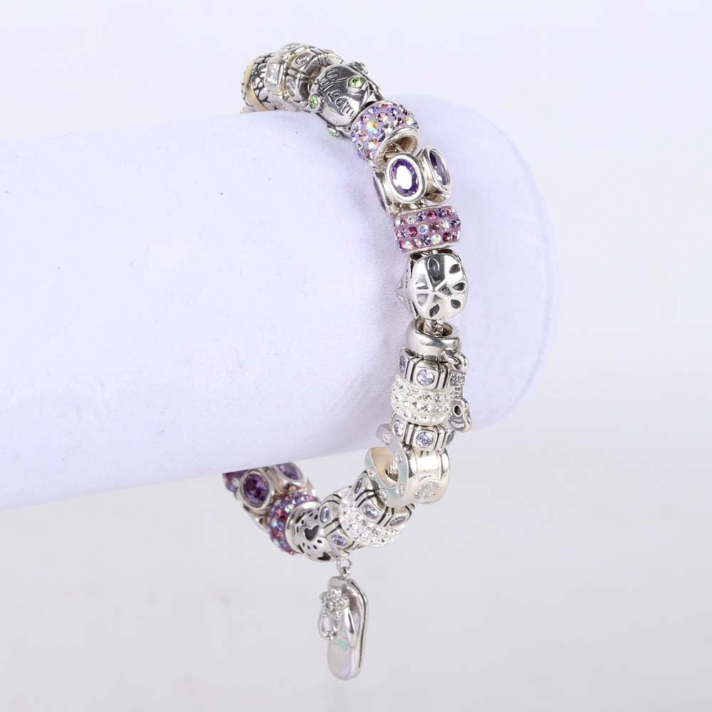 Sterling Silver Bracelet with Twenty-Four Assorted Charms