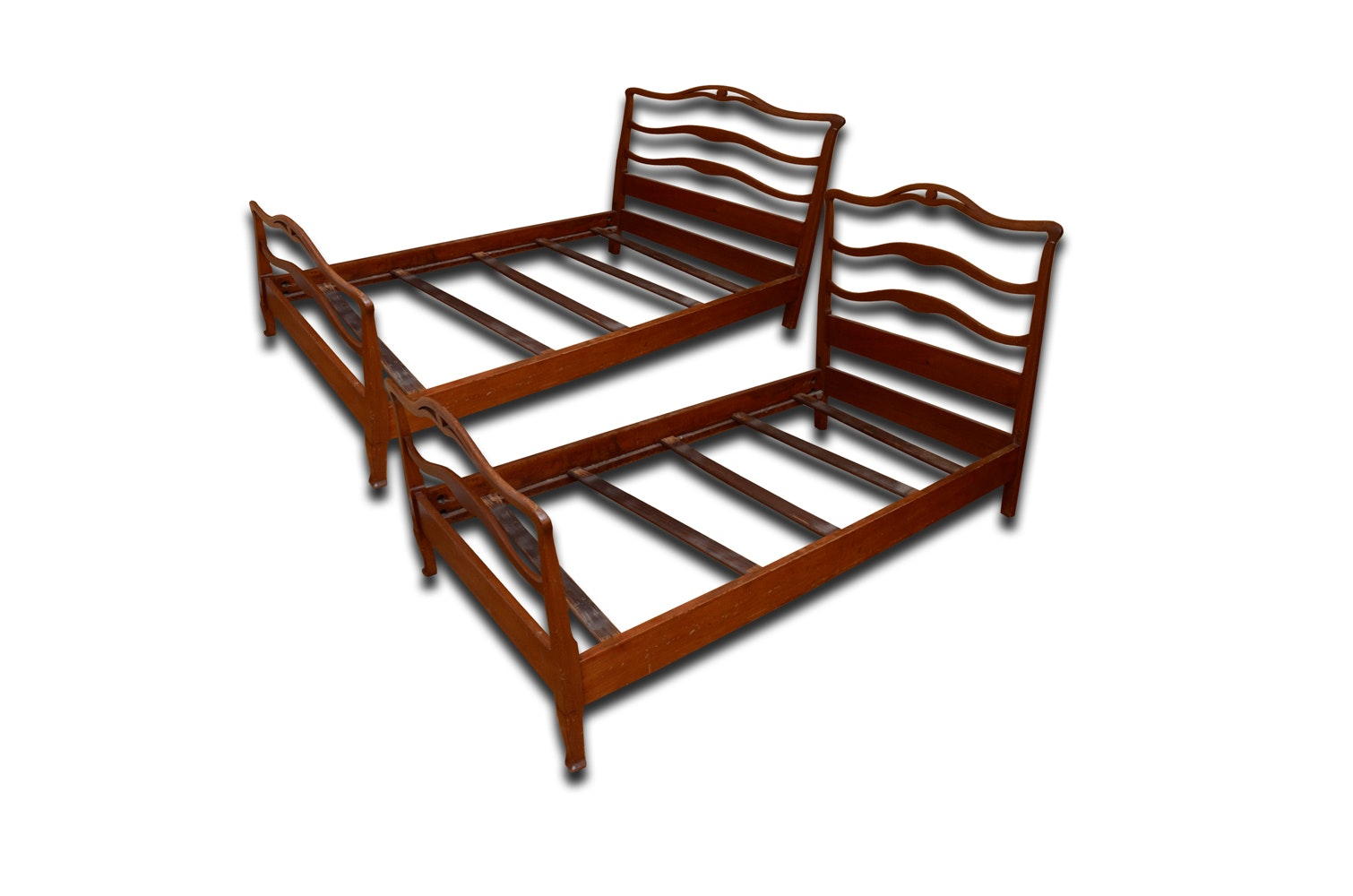 pair of vintage wooden twin beds