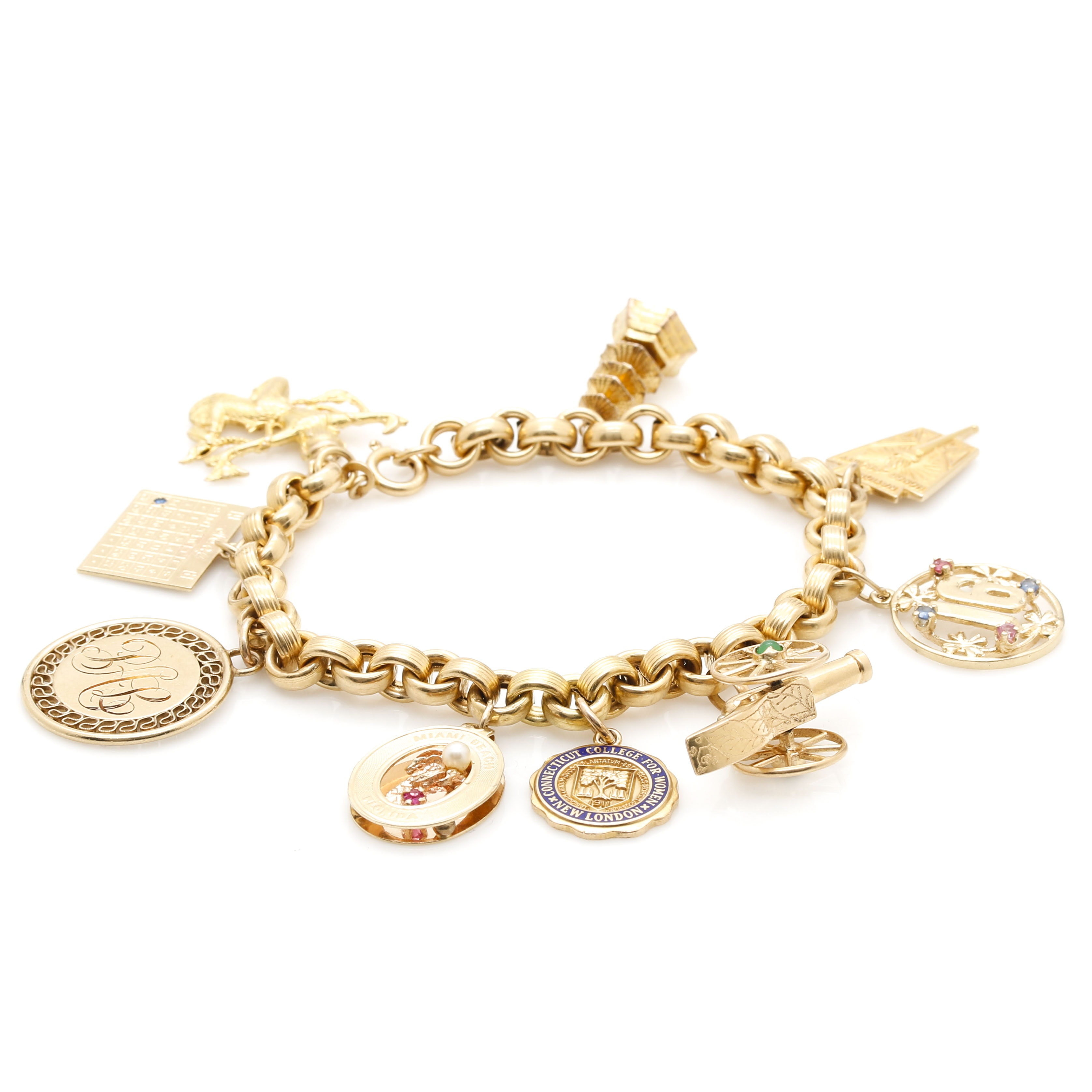 18K Yellow Gold Bracelet Featuring Assorted Gold and Gemstone Charms