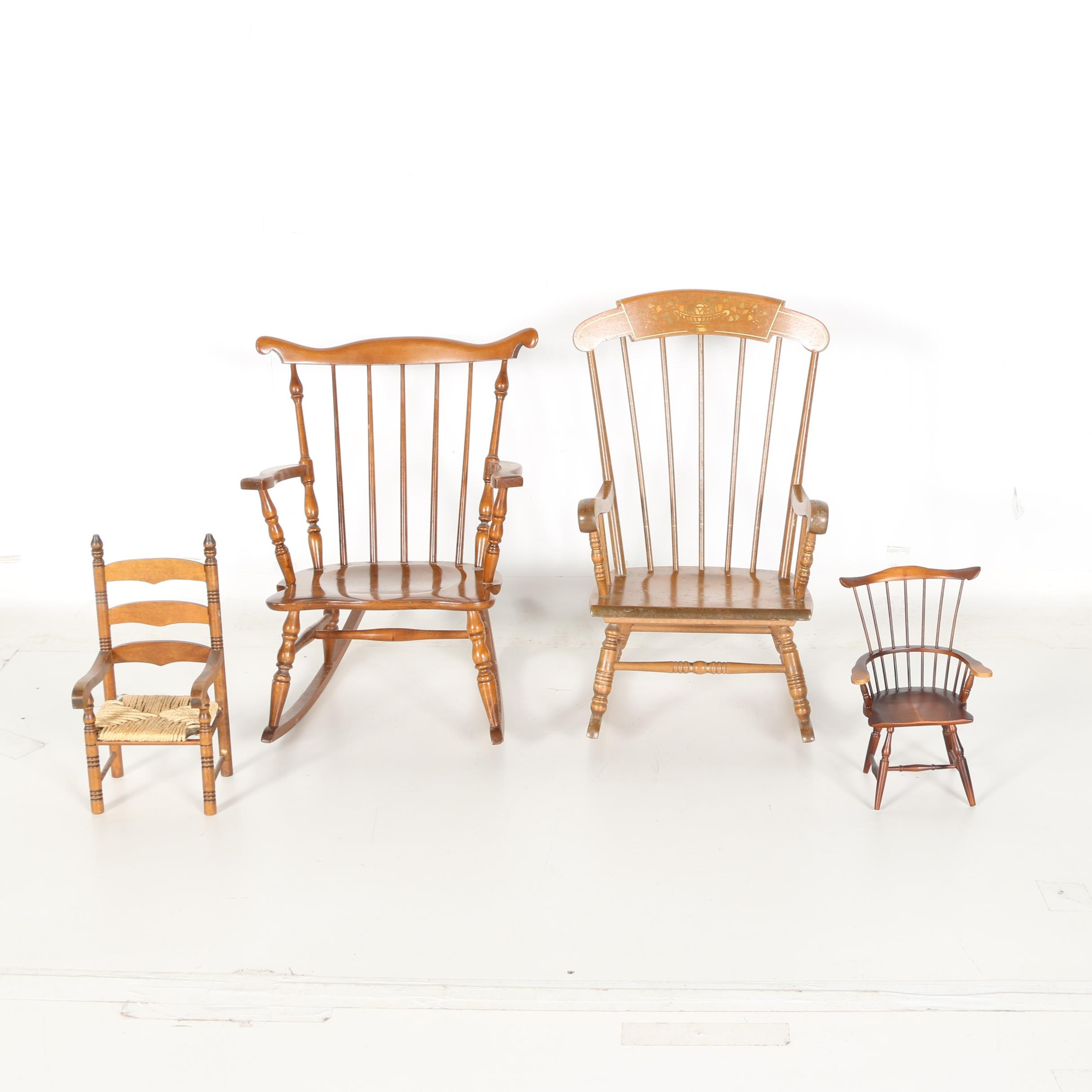 Four Windsor Style Rocking Chairs