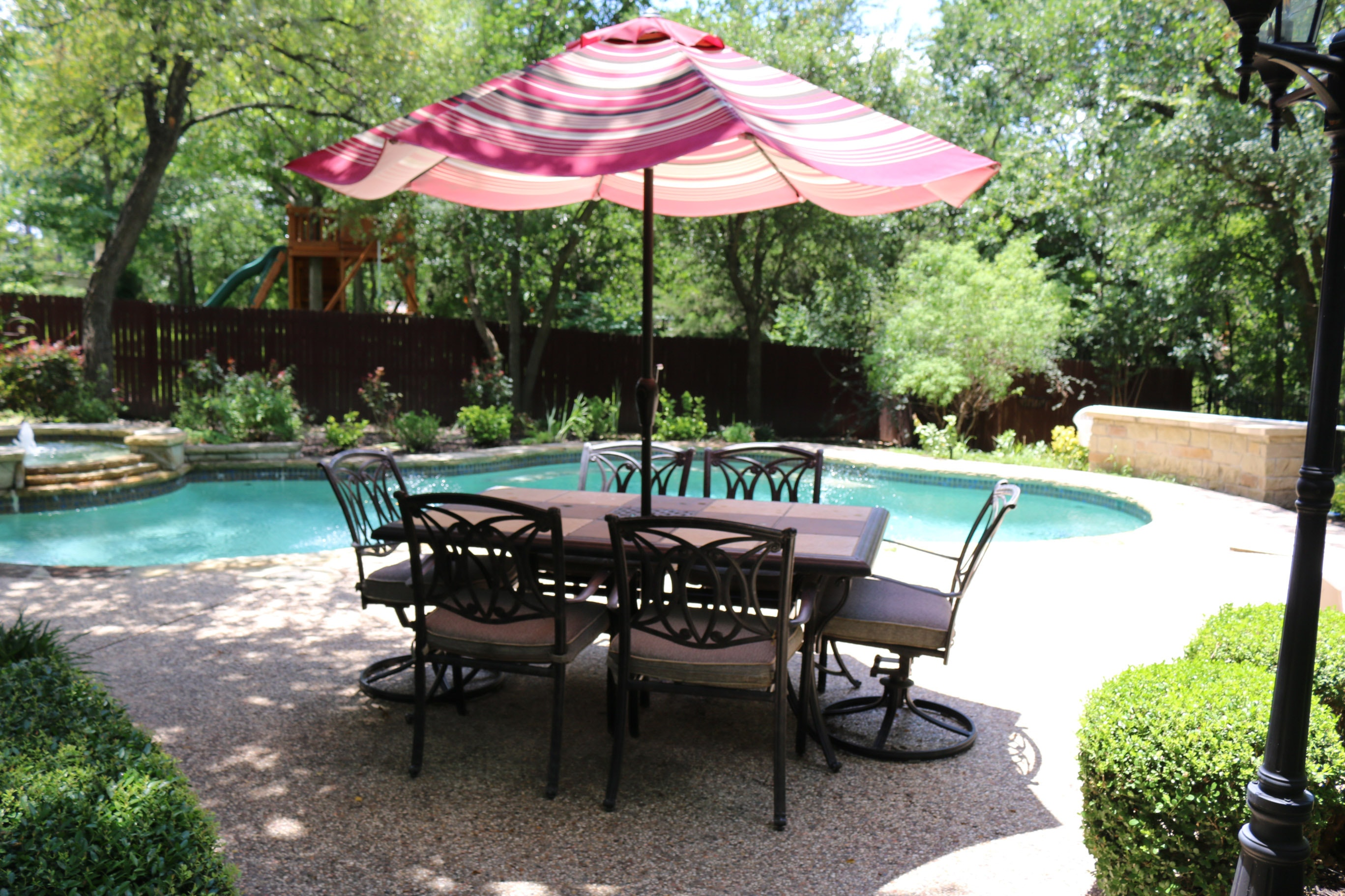 outdoor patio table with chairs and umbrella ebth rh ebth com Patio Table with Chairs Drawing Patio Table and Chair Sets