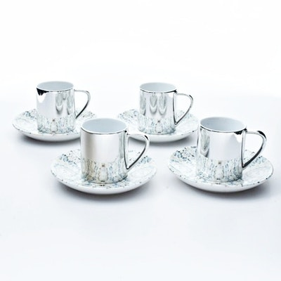 """Four Damien Hirst """"Virtue"""" Electroplated Cups and Saucers"""