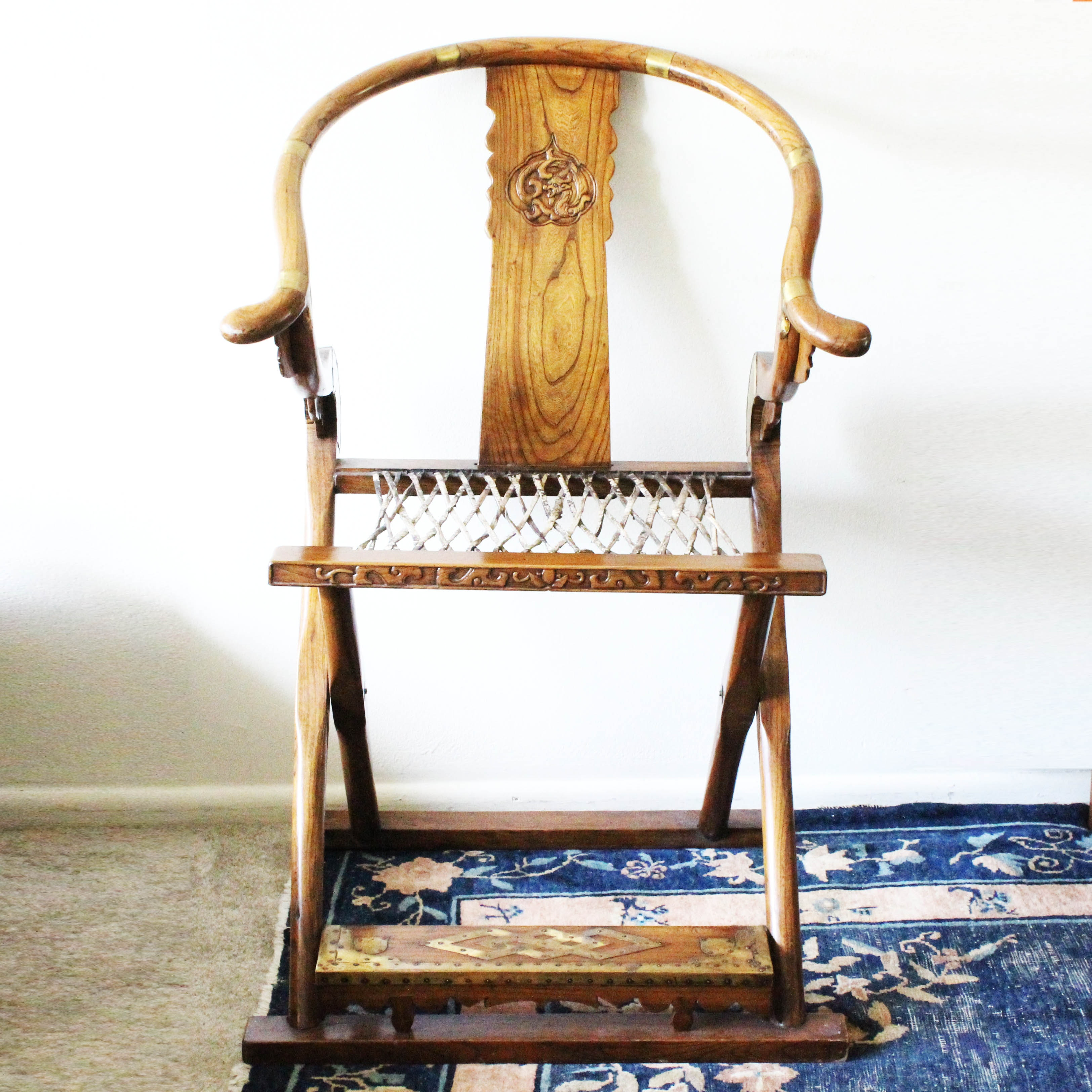Chinese Ming dynasty hardwood folding chair, dragon craved symbol
