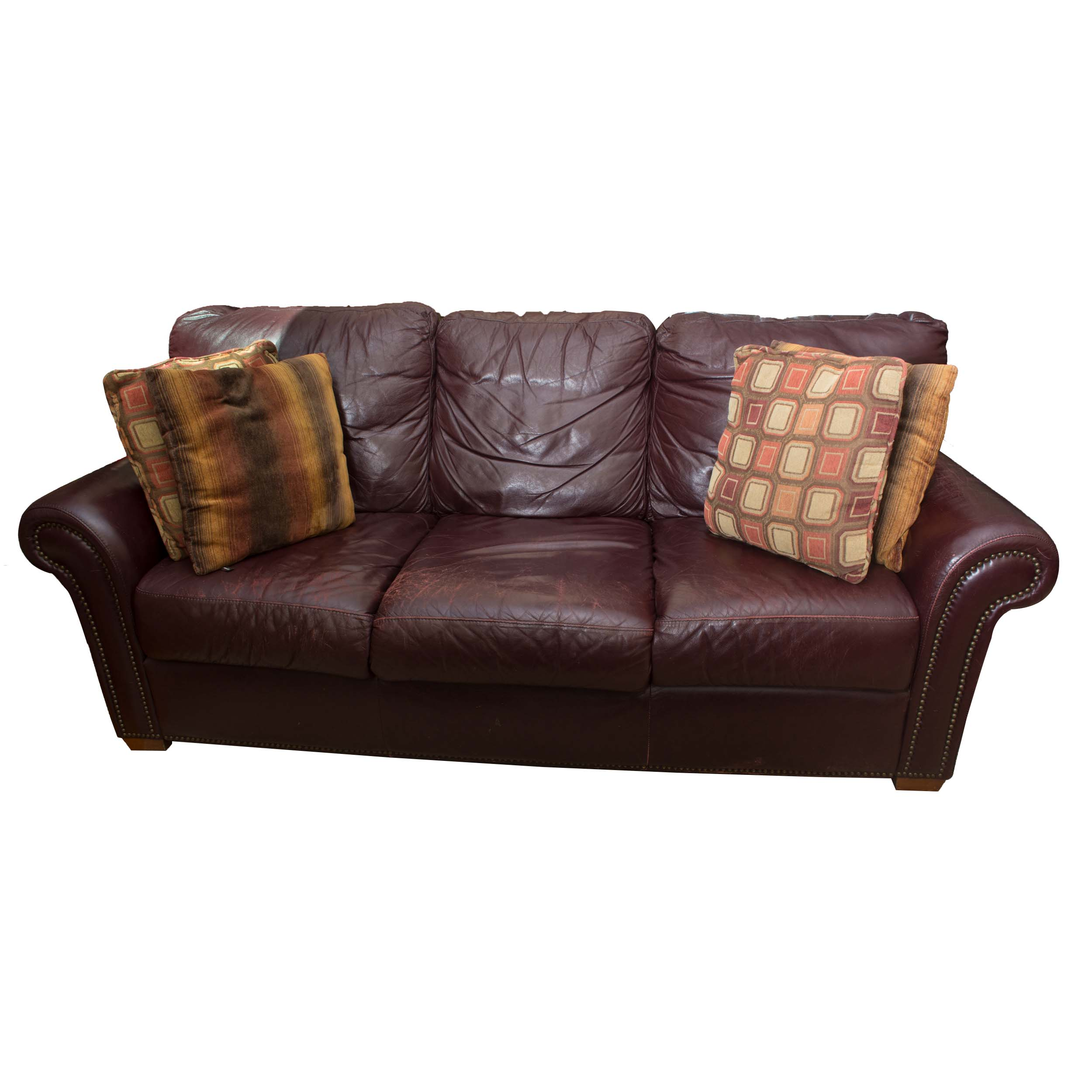 Burgundy Leather Sofa With Accent Pillows