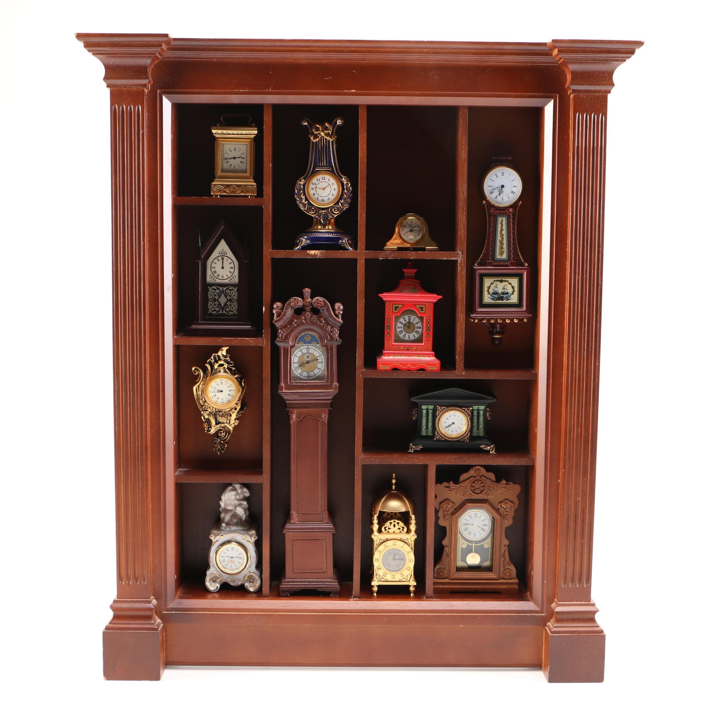 Franklin Mint Miniature Clocks With Display Cabinet