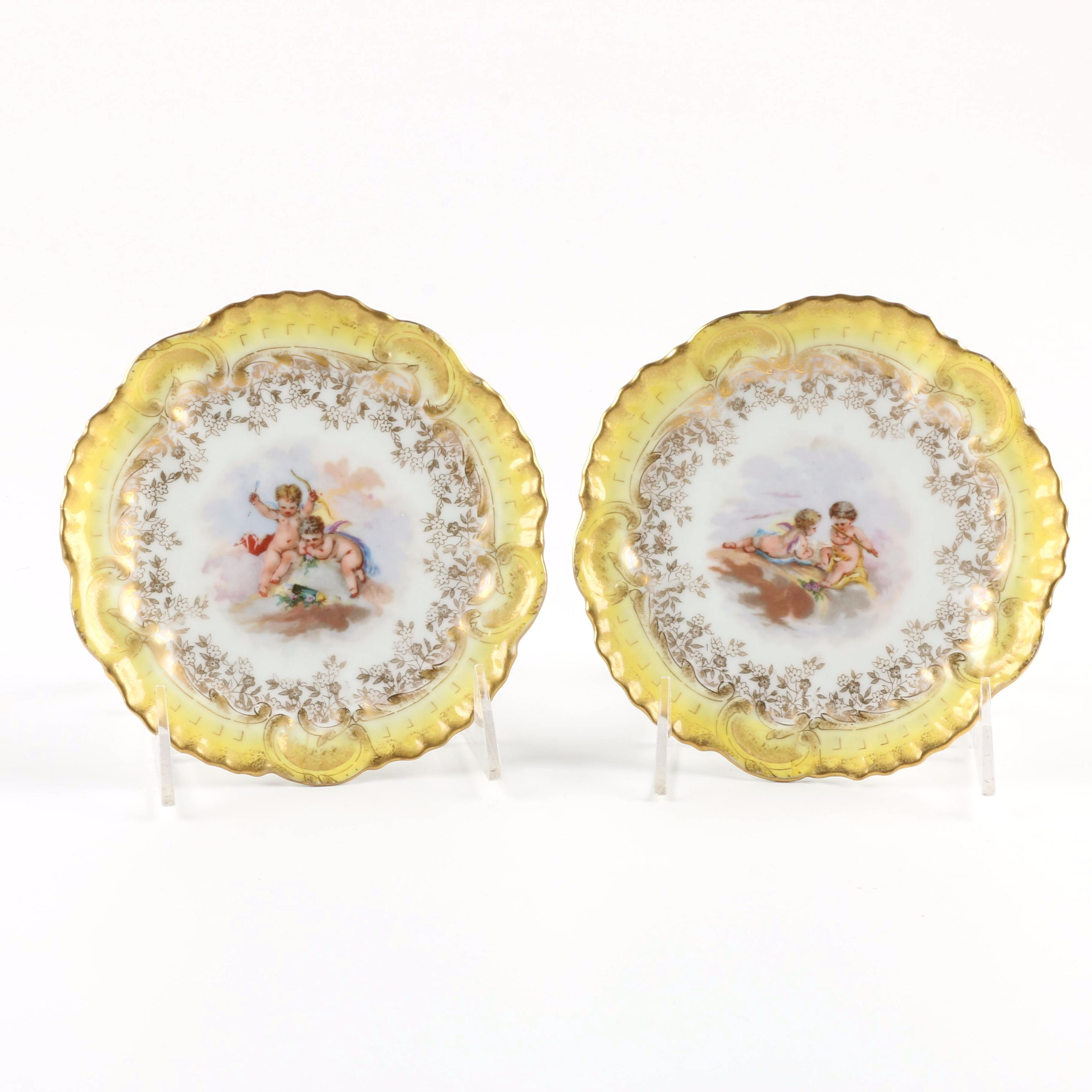Two A. Laternier Limoges Plates with Hand Painted Cherub Scenes