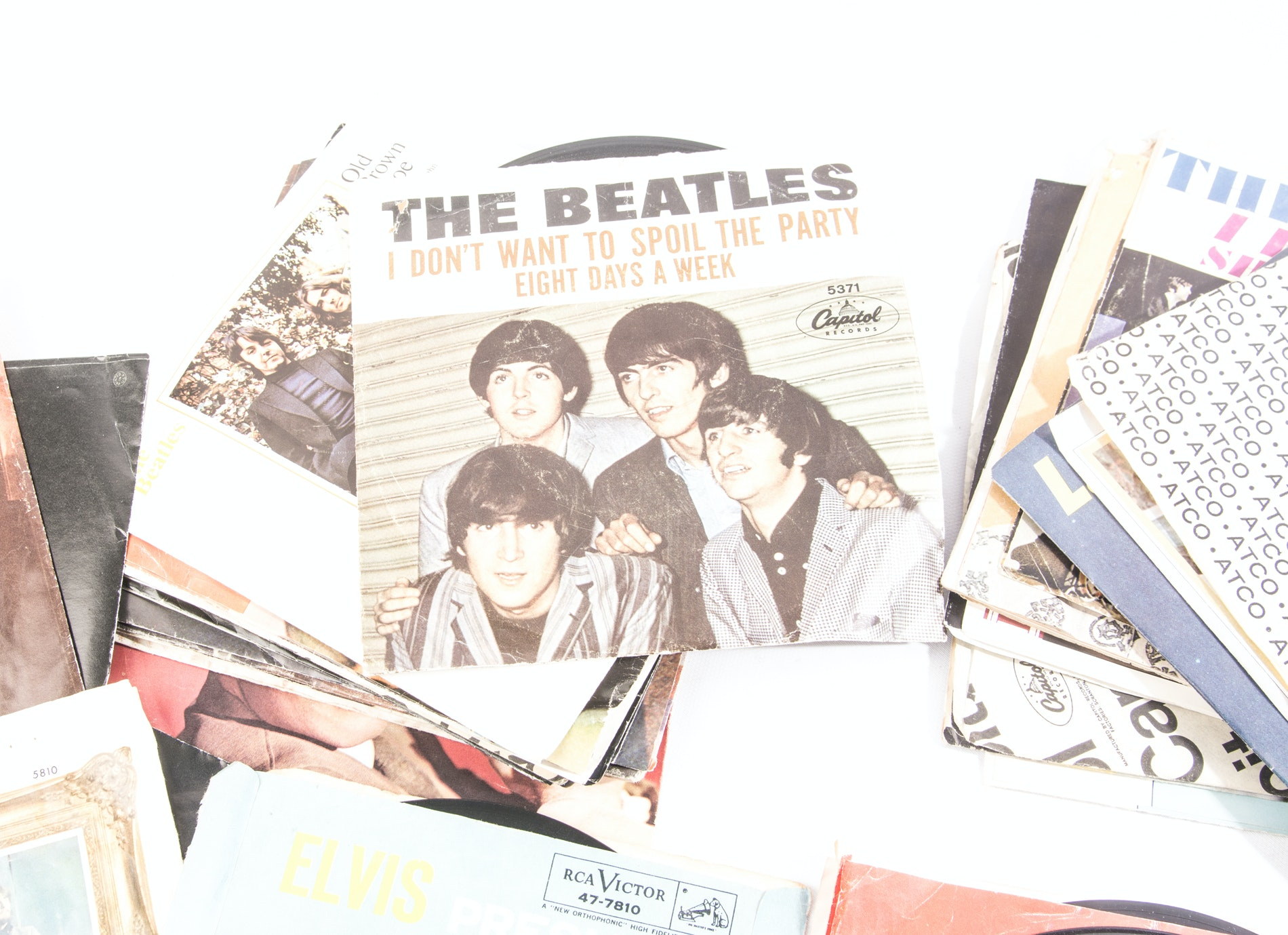 Vintage Collection of Vinyl 45 Records and Beatles Paraphernalia