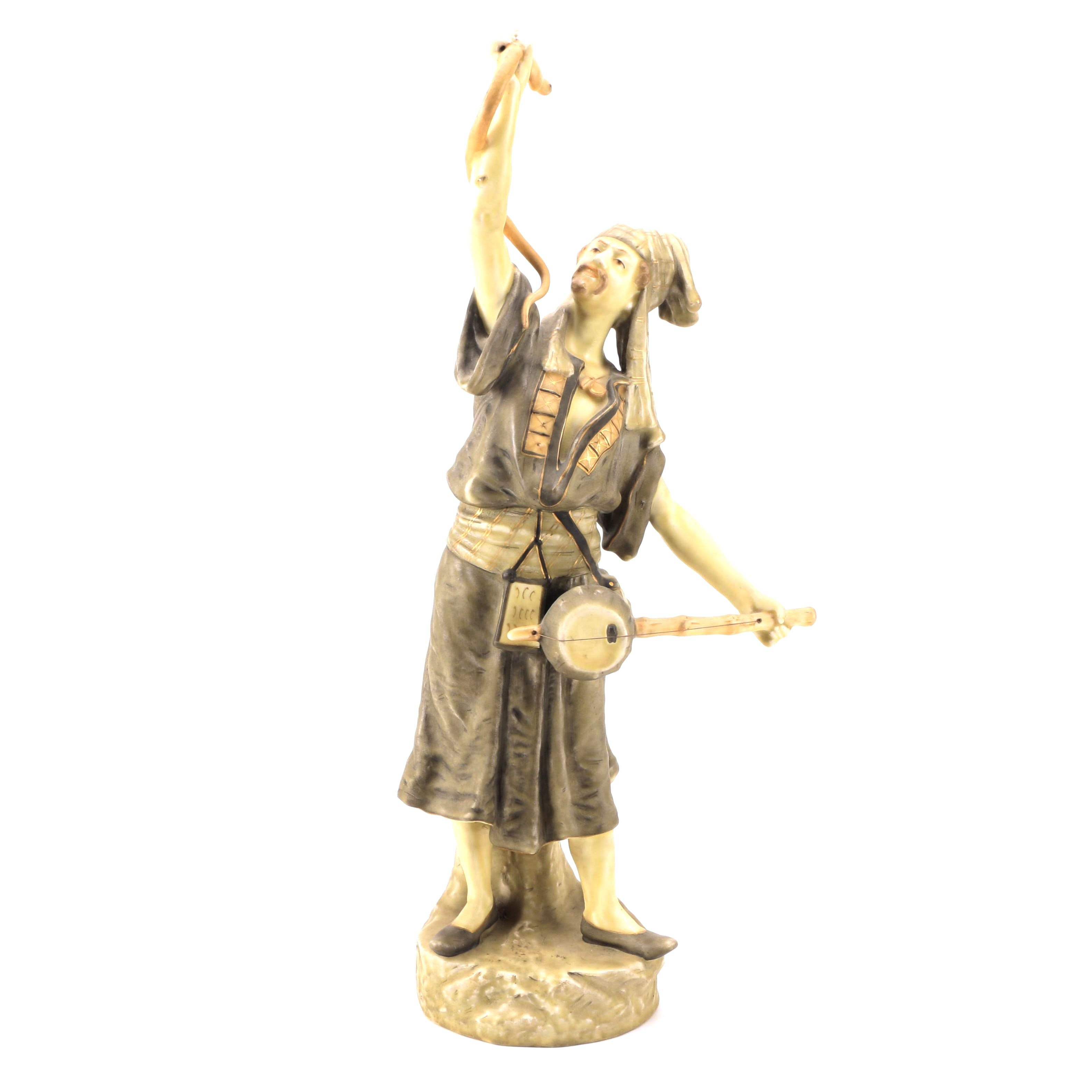 East Asian Style Ceramic Statue of Man Holding Snake