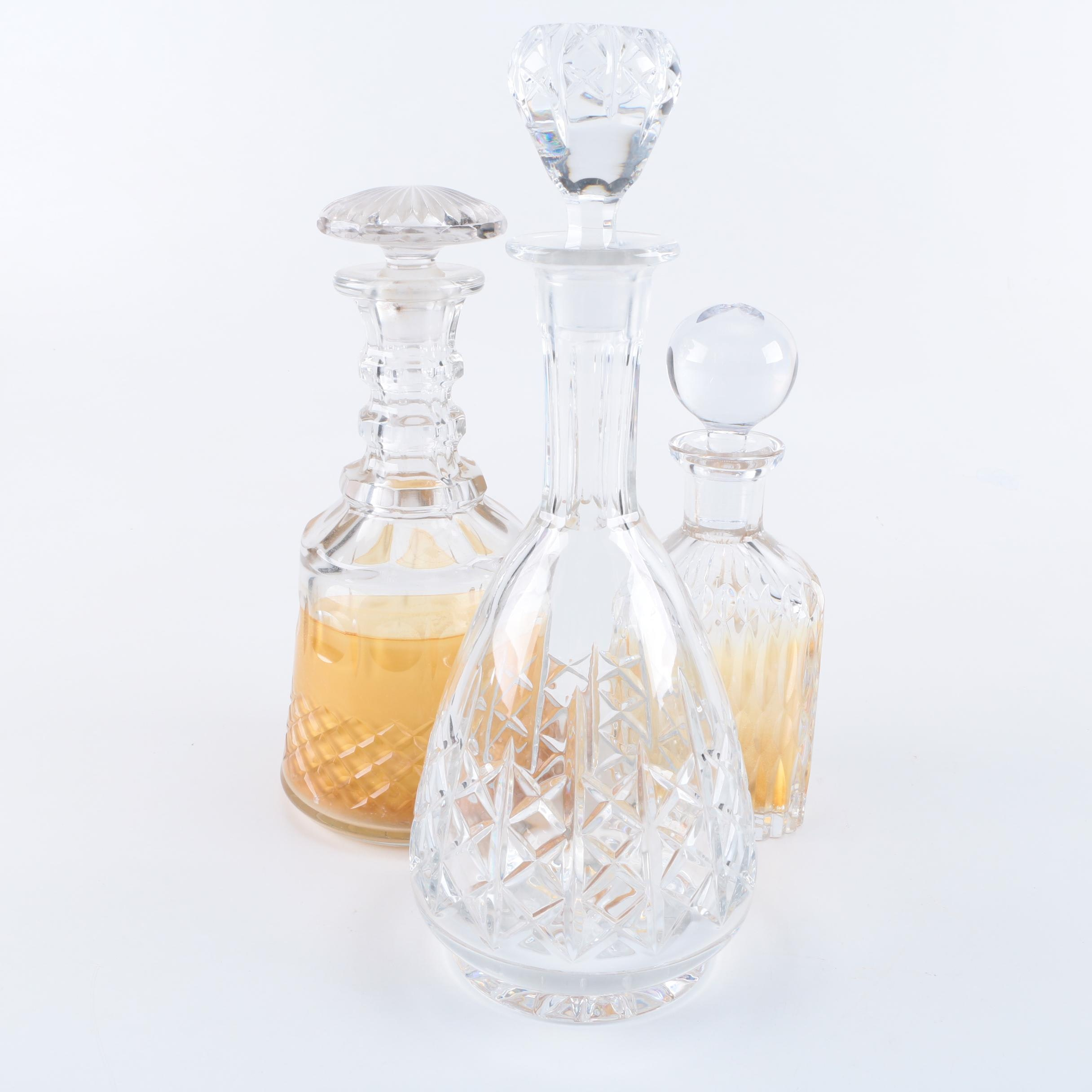 Three Crystal and Glass Decanters
