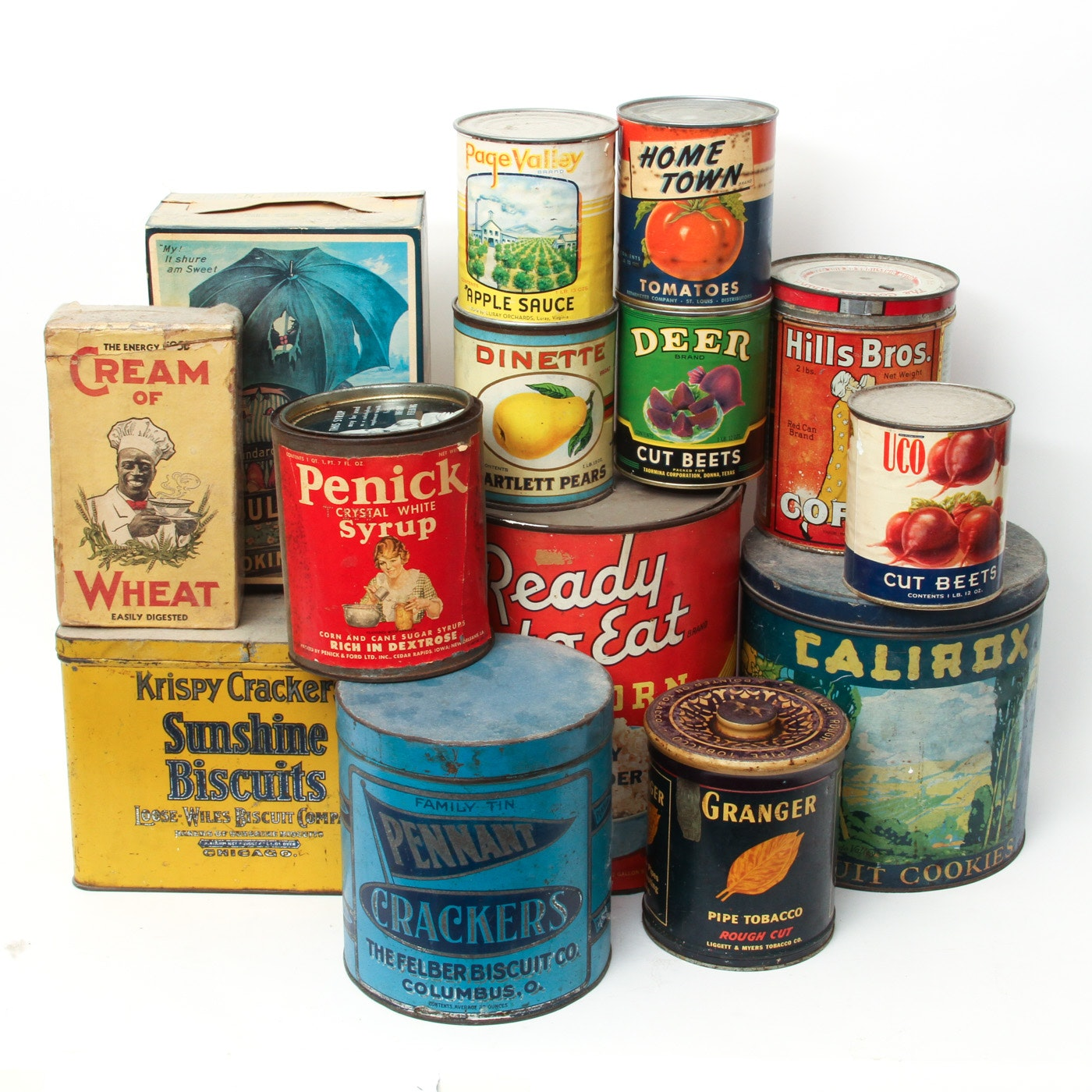 Collection of Vintage Cans featuring Graphic Labels