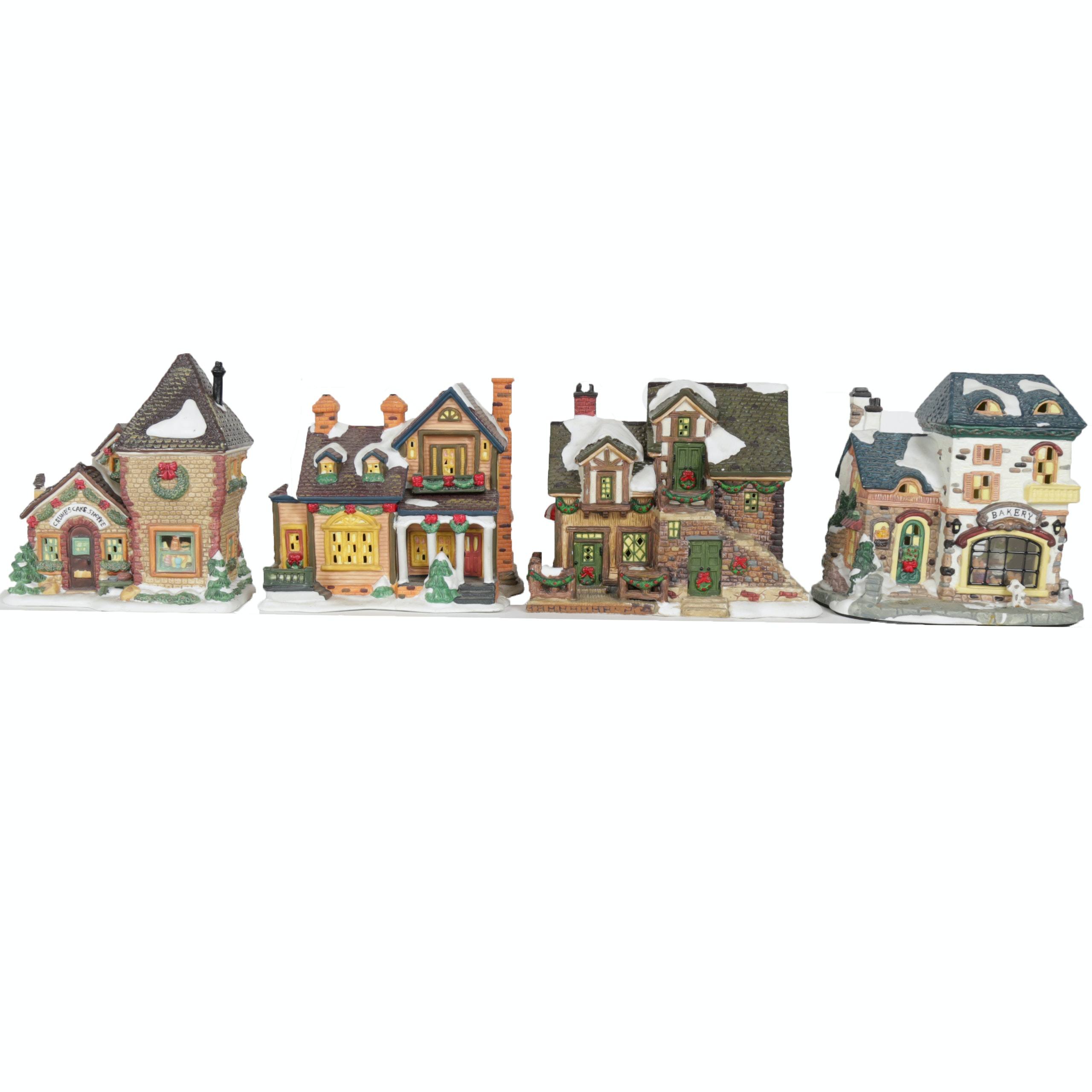 "Collection of ""Santa's Workbench Collection"" Illuminated Houses"