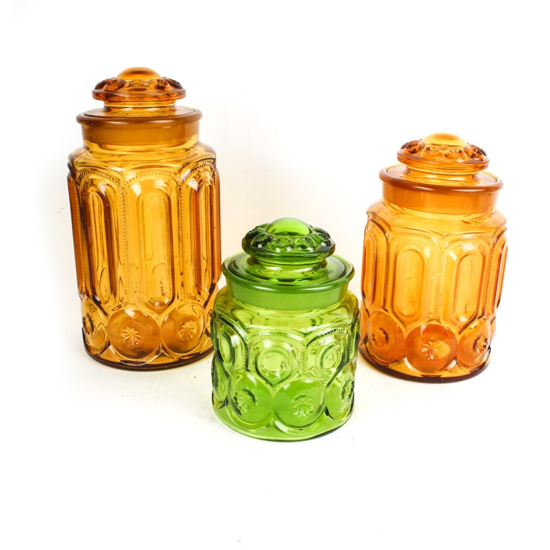 """Green and Amber """"Moon and Stars"""" Depression Glass Canisters"""