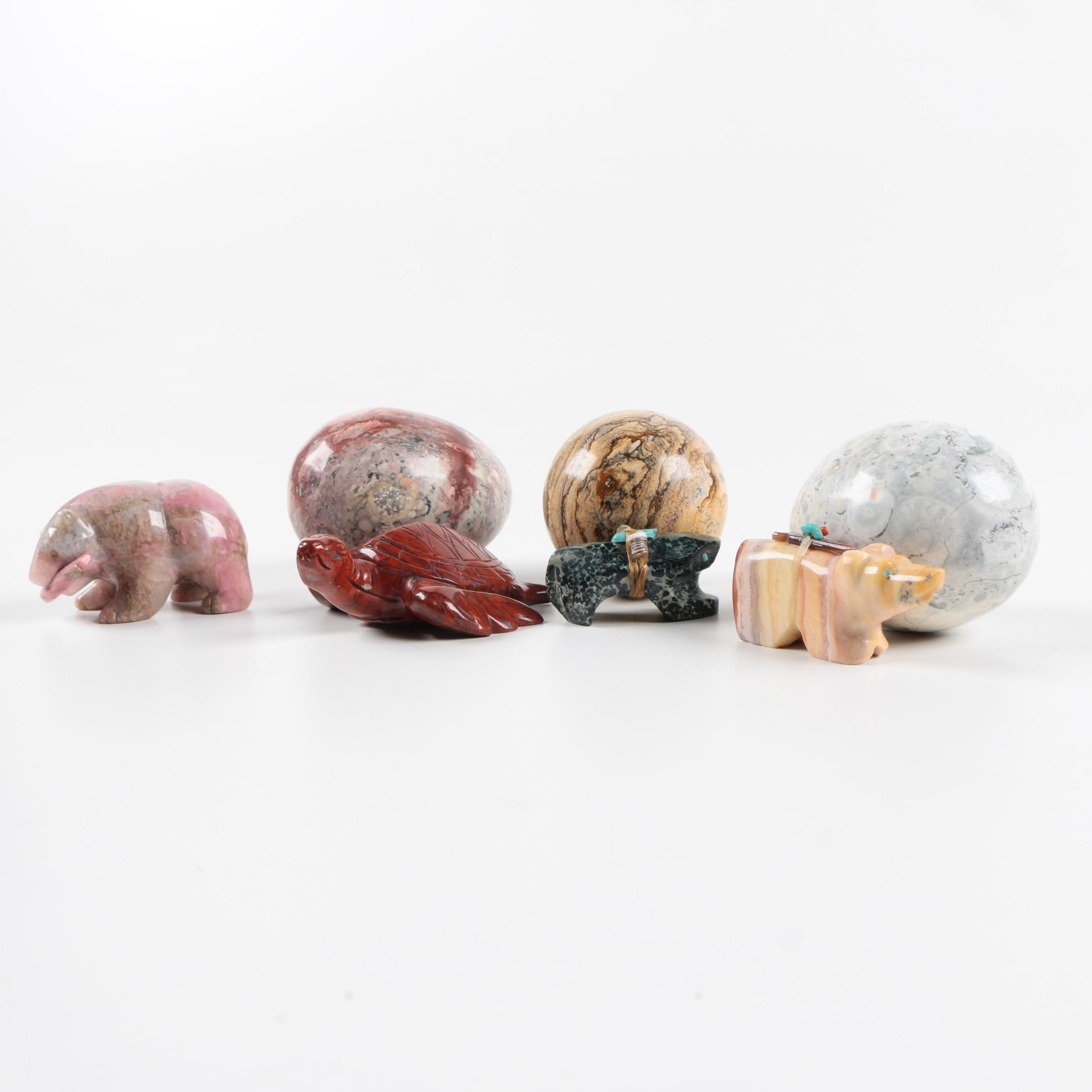 Carved Stone Orbs and Animal Figurines