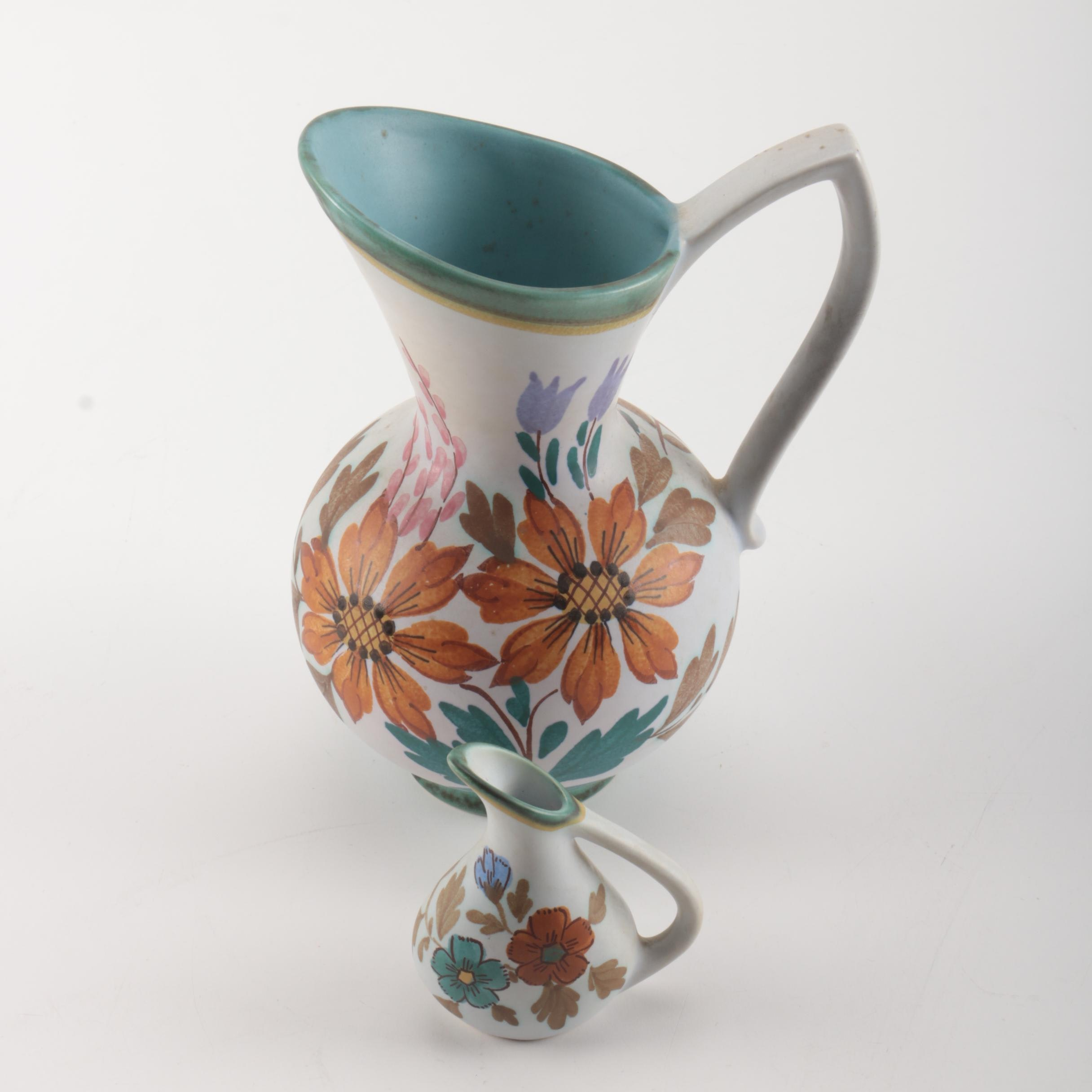 Pair of Flora Gouda Art Pottery Pitchers