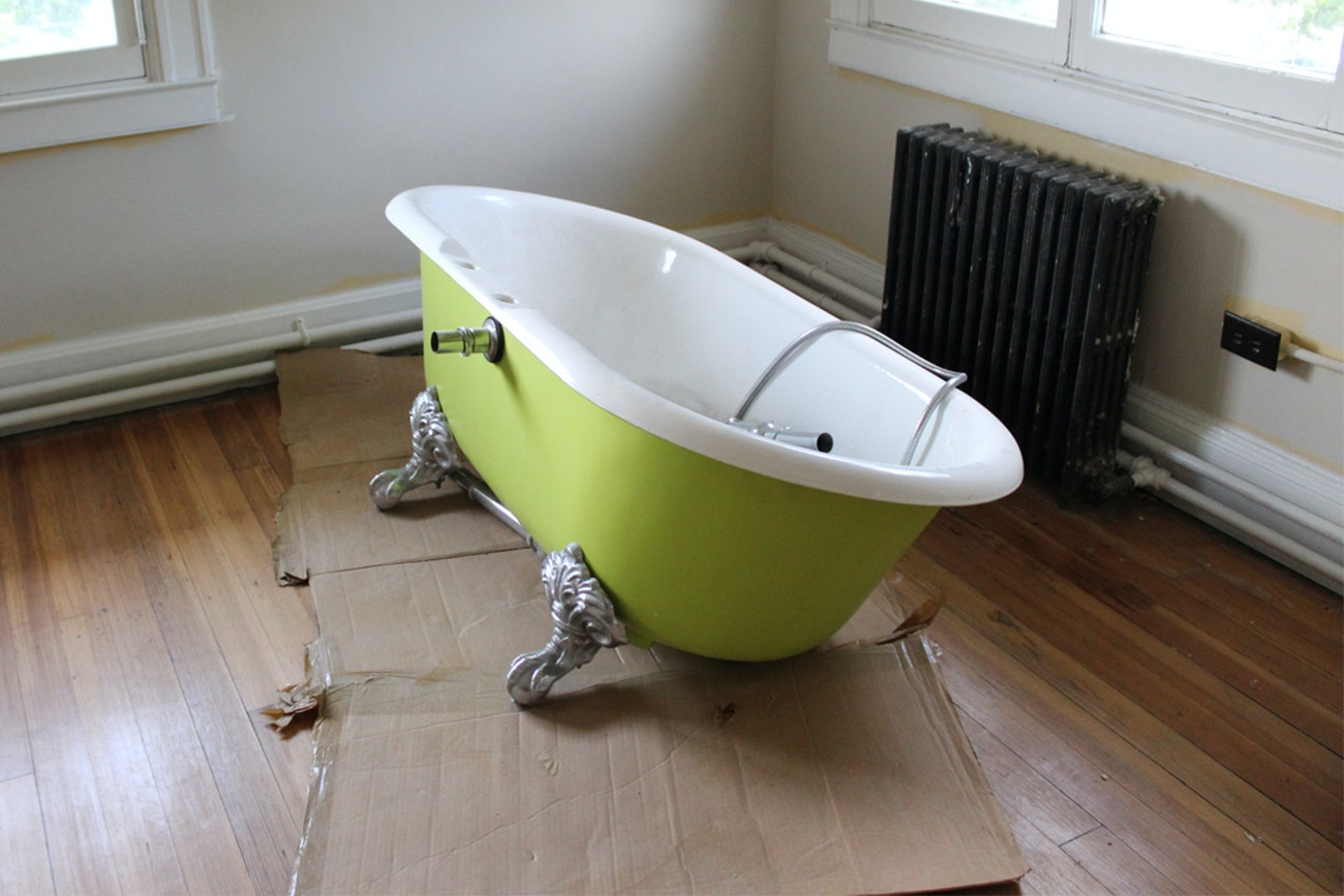 Vintage Green Painted Porcelain Claw Footed Bathtub