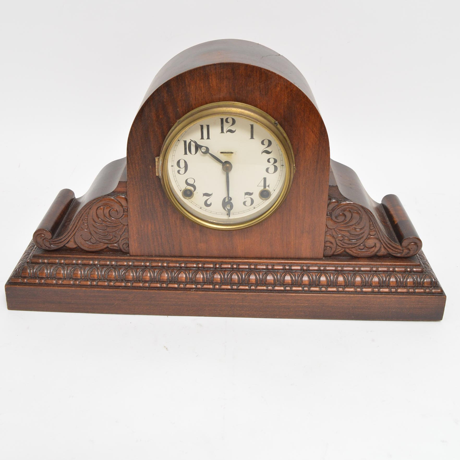 Carved Walnut Humpback Mantel Clock