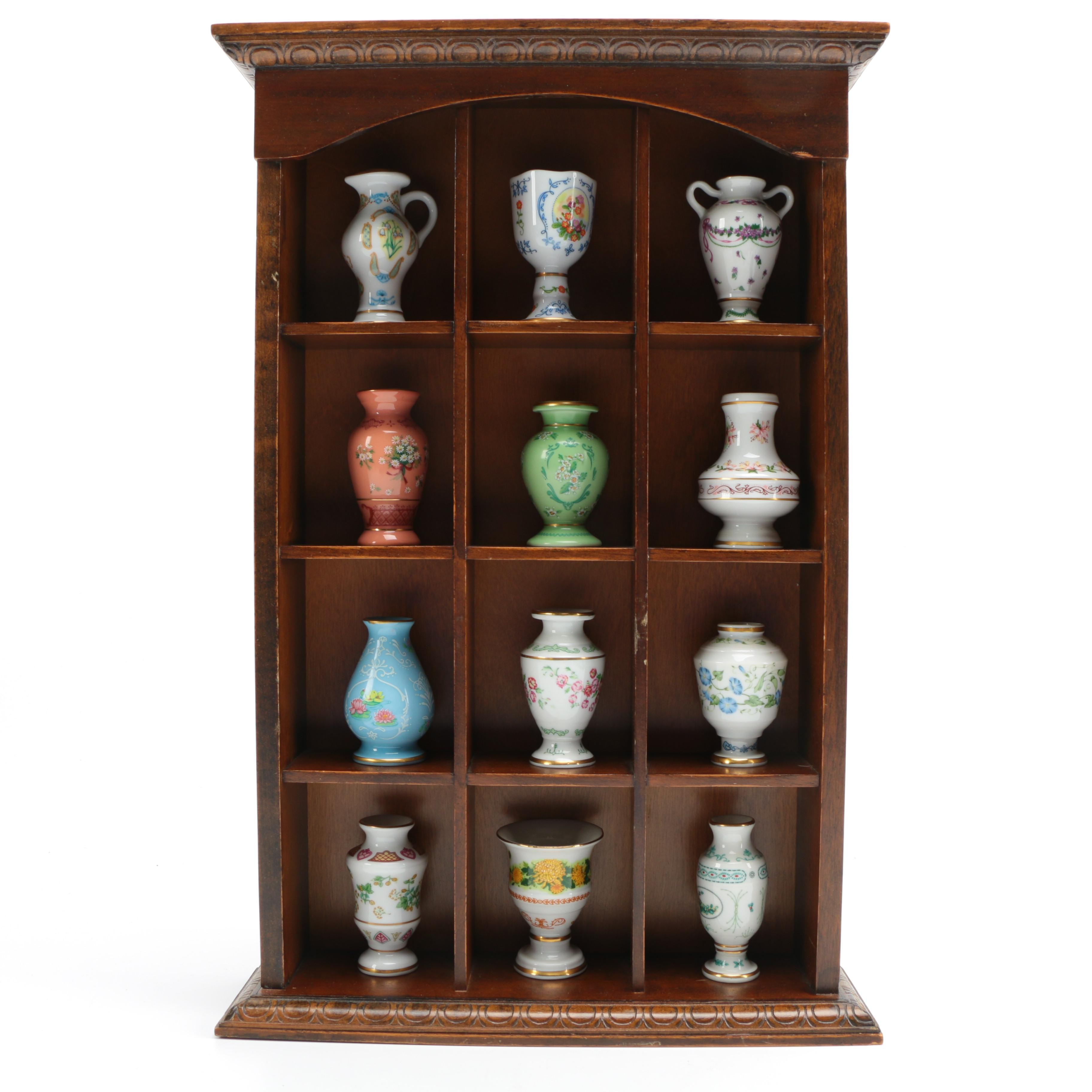 Collection of Twelve Japanese Porcelain Vases in Divided Display Shelf