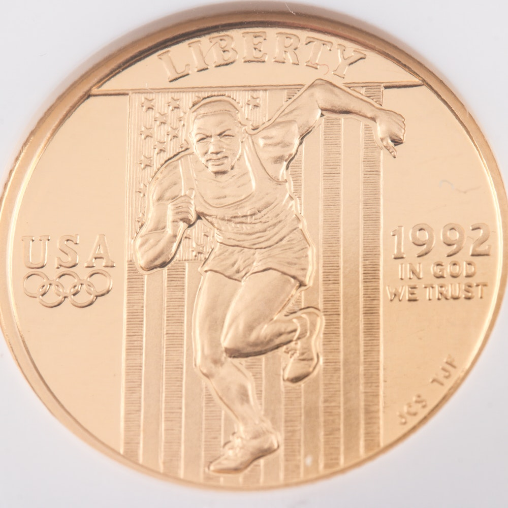 Encapsulated and Graded PF70 Ultra Cameo (by NGC) 1992 W $5 Olympic Commemorative Gold Coin