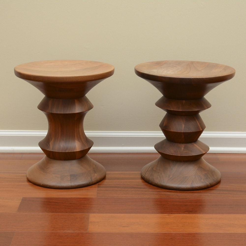 Pair Of Eames Carved Walnut Stools Ebth