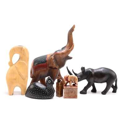 A Selection of Animal Themed Decor to Include Two Soapstone Carvings