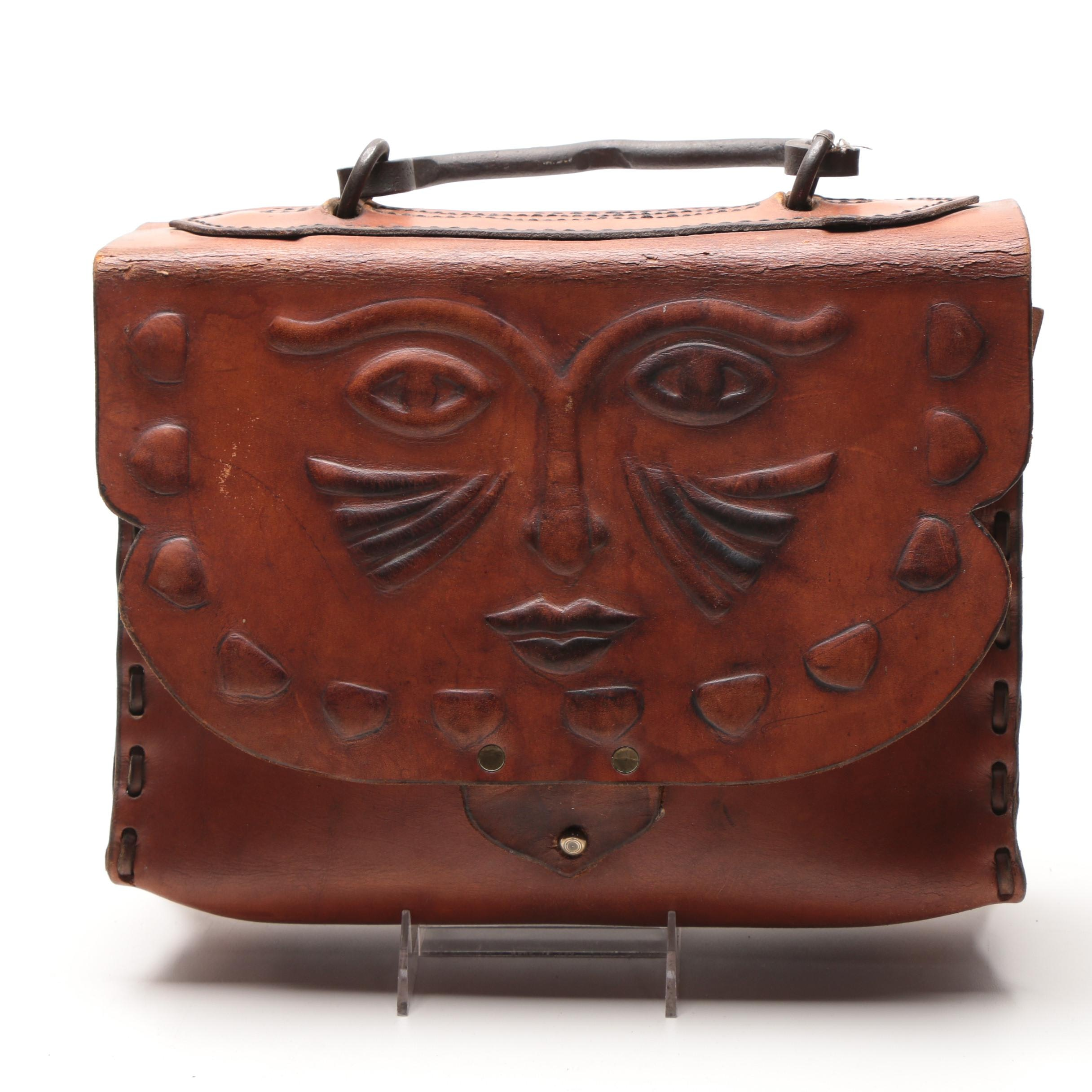 Leather Handbag with Embossed Face and Wrought Iron Handle