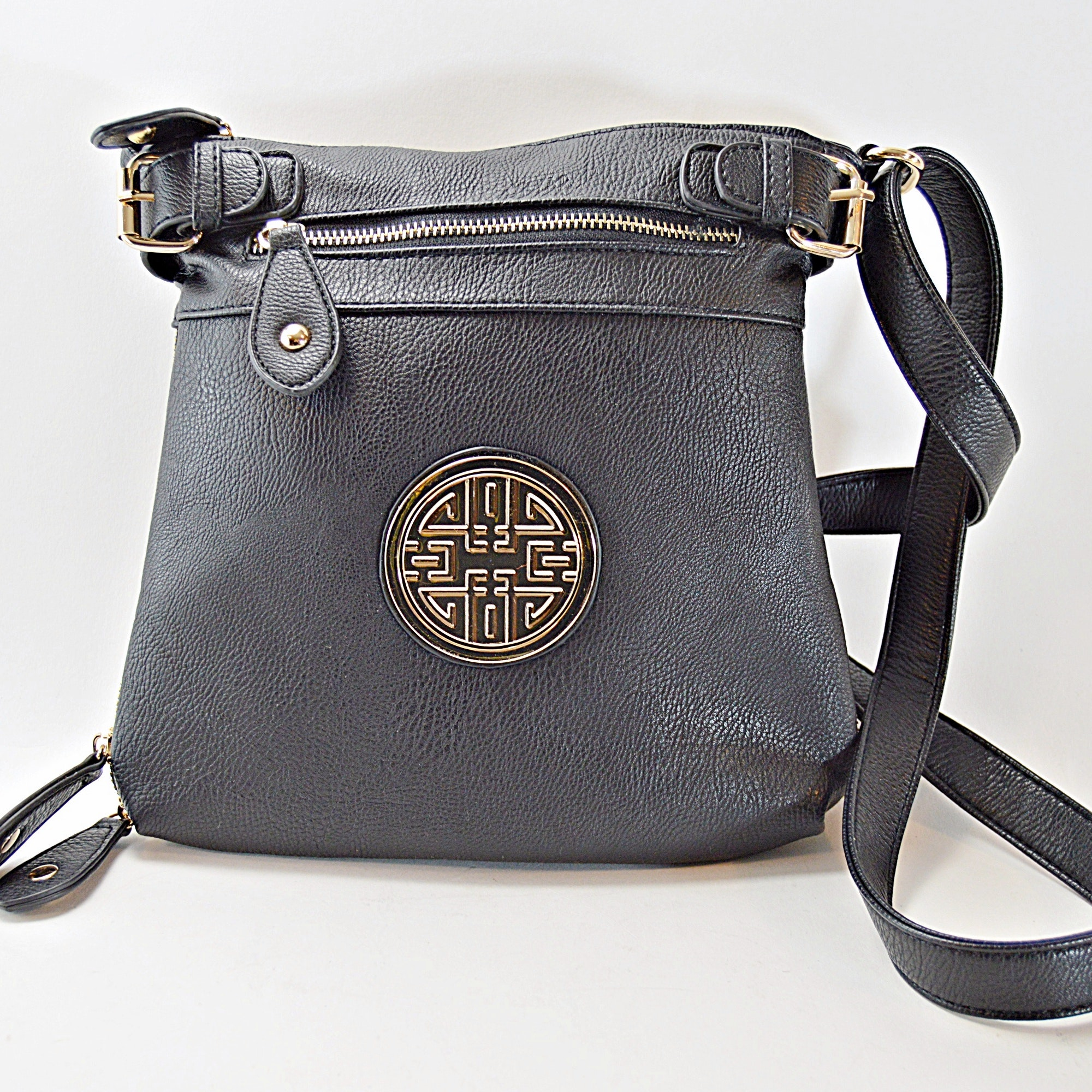Black Leather Handbag with Asian Medallion