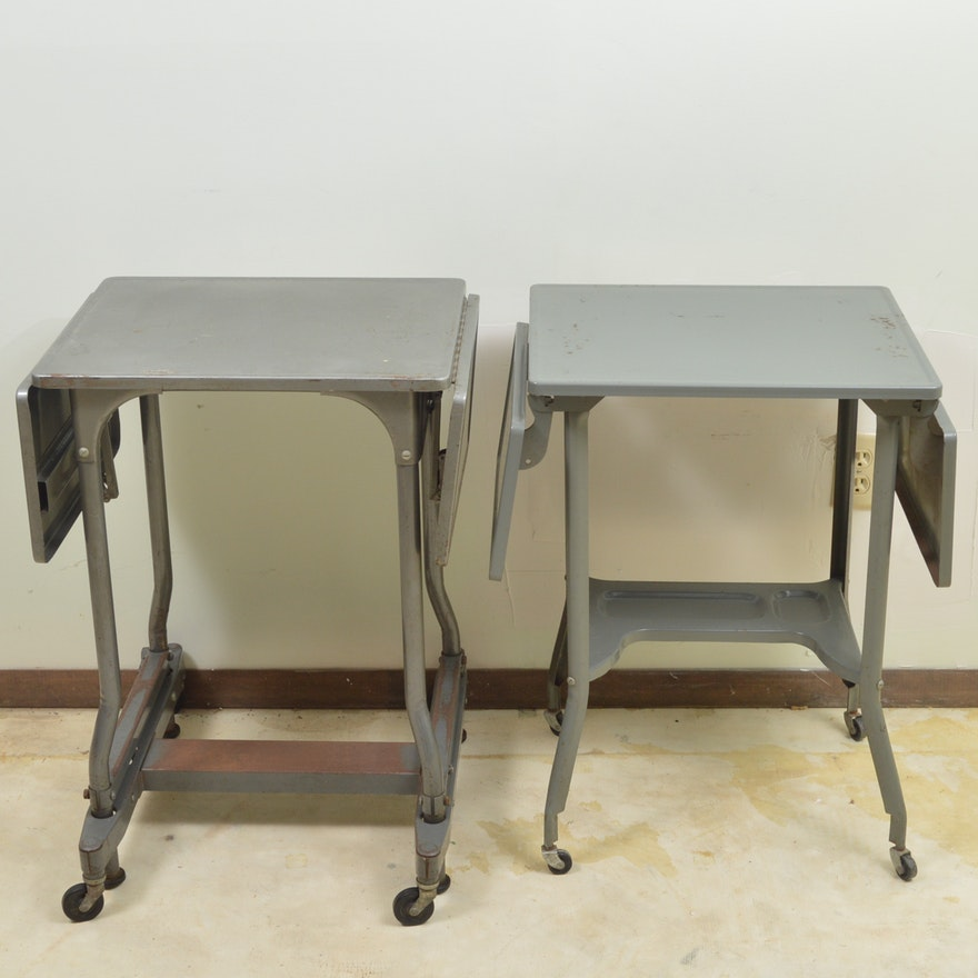 Two Gray Metal Drop Leaf Tables On Wheels