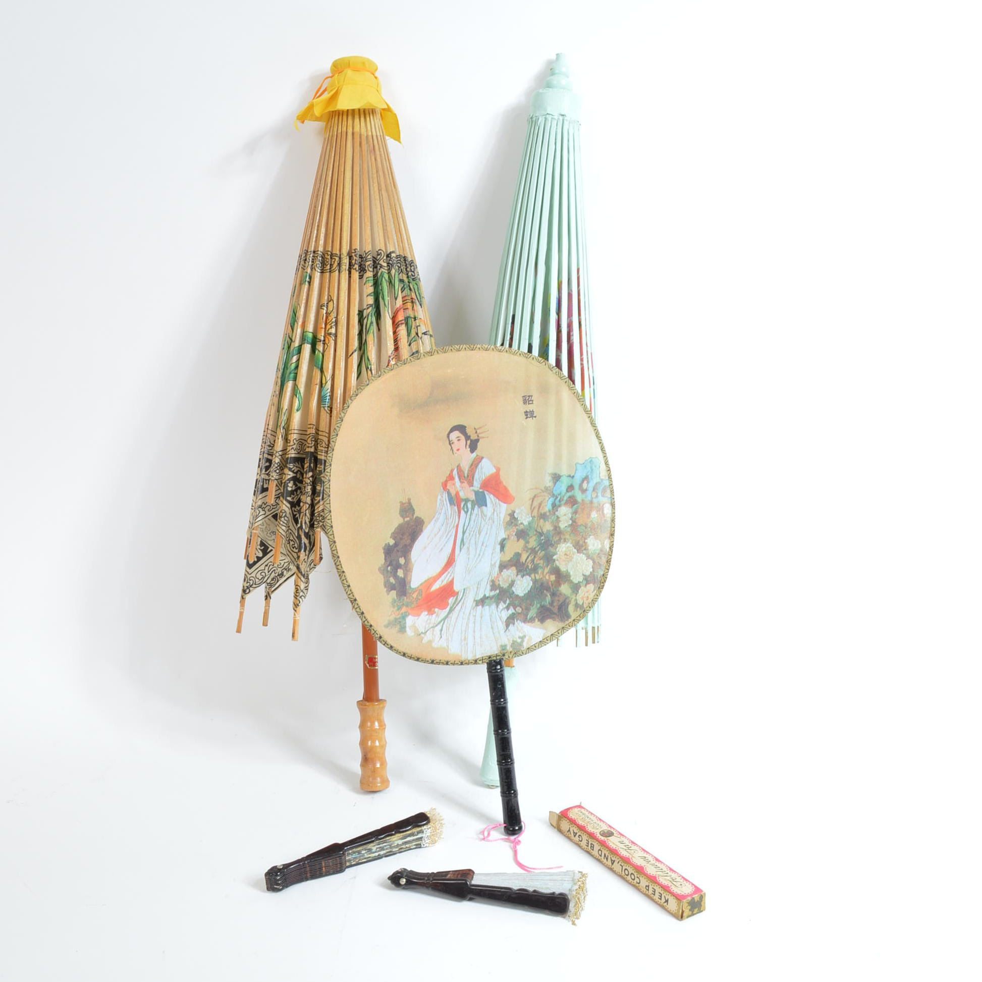 Assortment of Paper Parasols and Fans