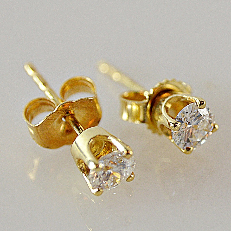Pair of 14K Yellow Gold and Diamond Stud Earrings