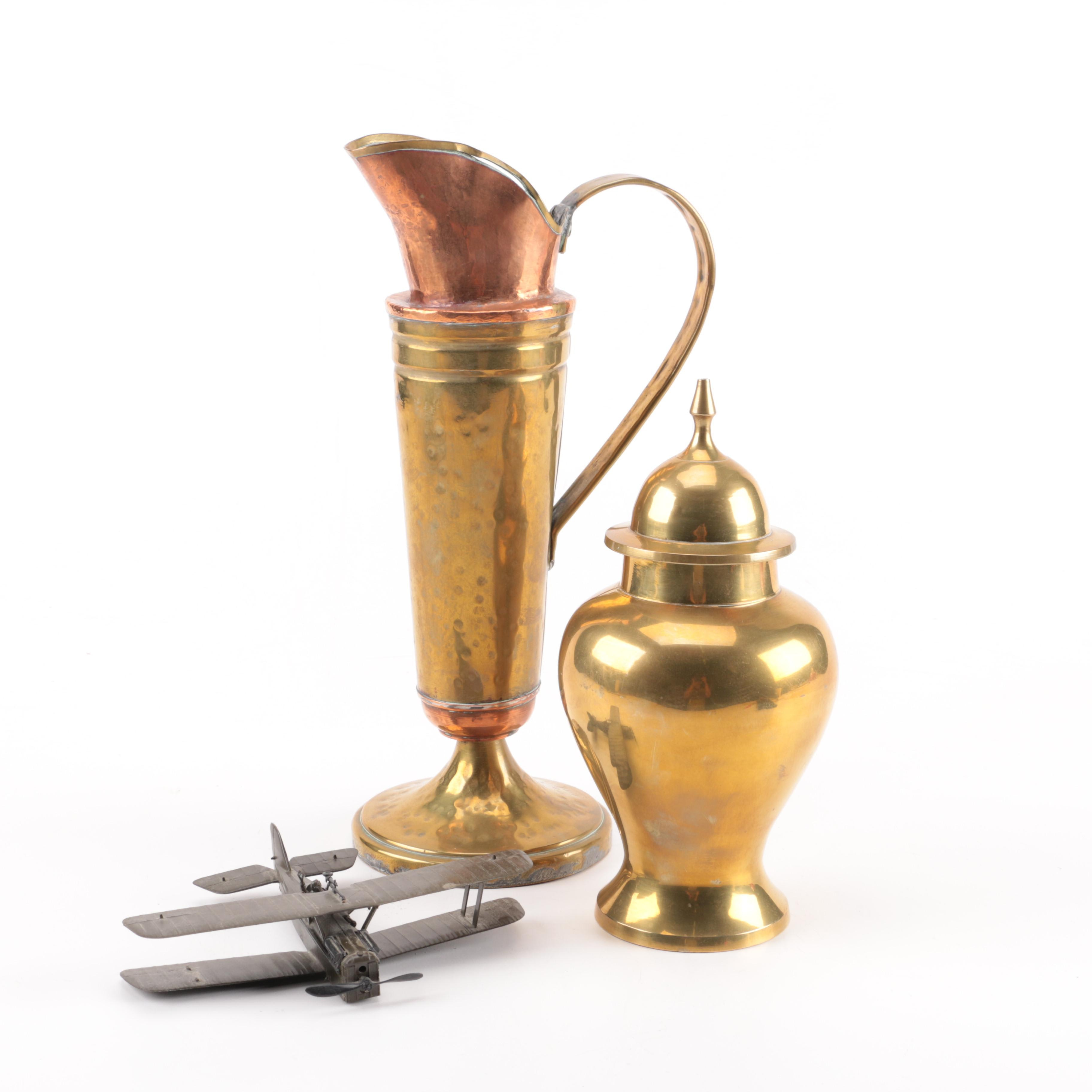 Copper and Brass Pitcher, Brass Urn and a Die Cast Plane